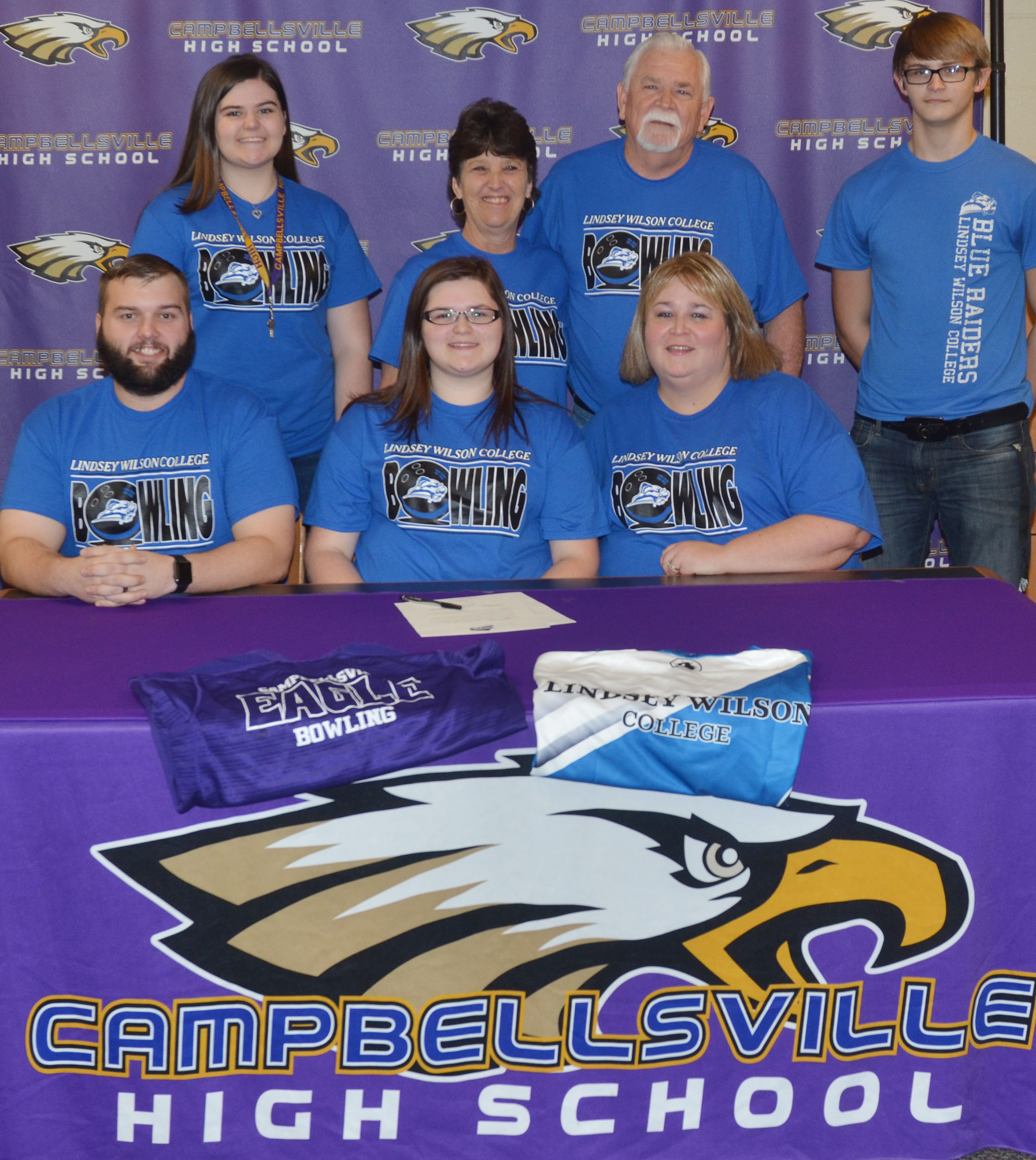 Campbellsville High School senior Vera Brown will continue her academic and bowling career at Lindsey Wilson College in the fall. She officially signed her letter of intent in a special ceremony on Wednesday, Feb. 1. From left, front, are stepfather Andrew Tate, Vera, and mother Tonya Tate. Back, sister and CHS junior Vivian Brown, grandmother Sandy Holmes, grandfather Allen Holmes and brother and CHS freshman Dalton Brown.