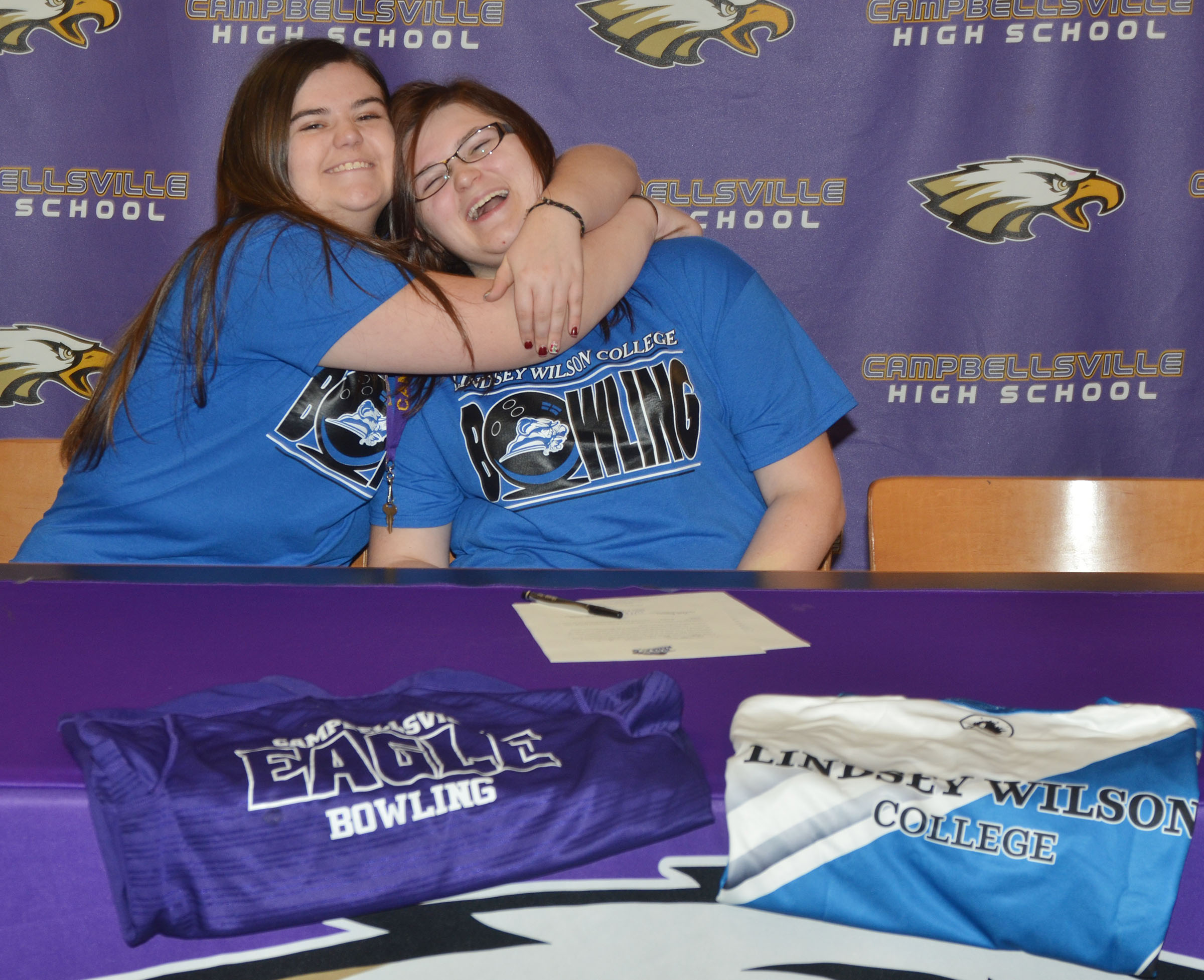Campbellsville High School senior Vera Brown will continue her academic and bowling career at Lindsey Wilson College in the fall. She officially signed her letter of intent in a special ceremony on Wednesday, Feb. 1. Above, she receives a hug from her sister, CHS junior Vivian Brown.