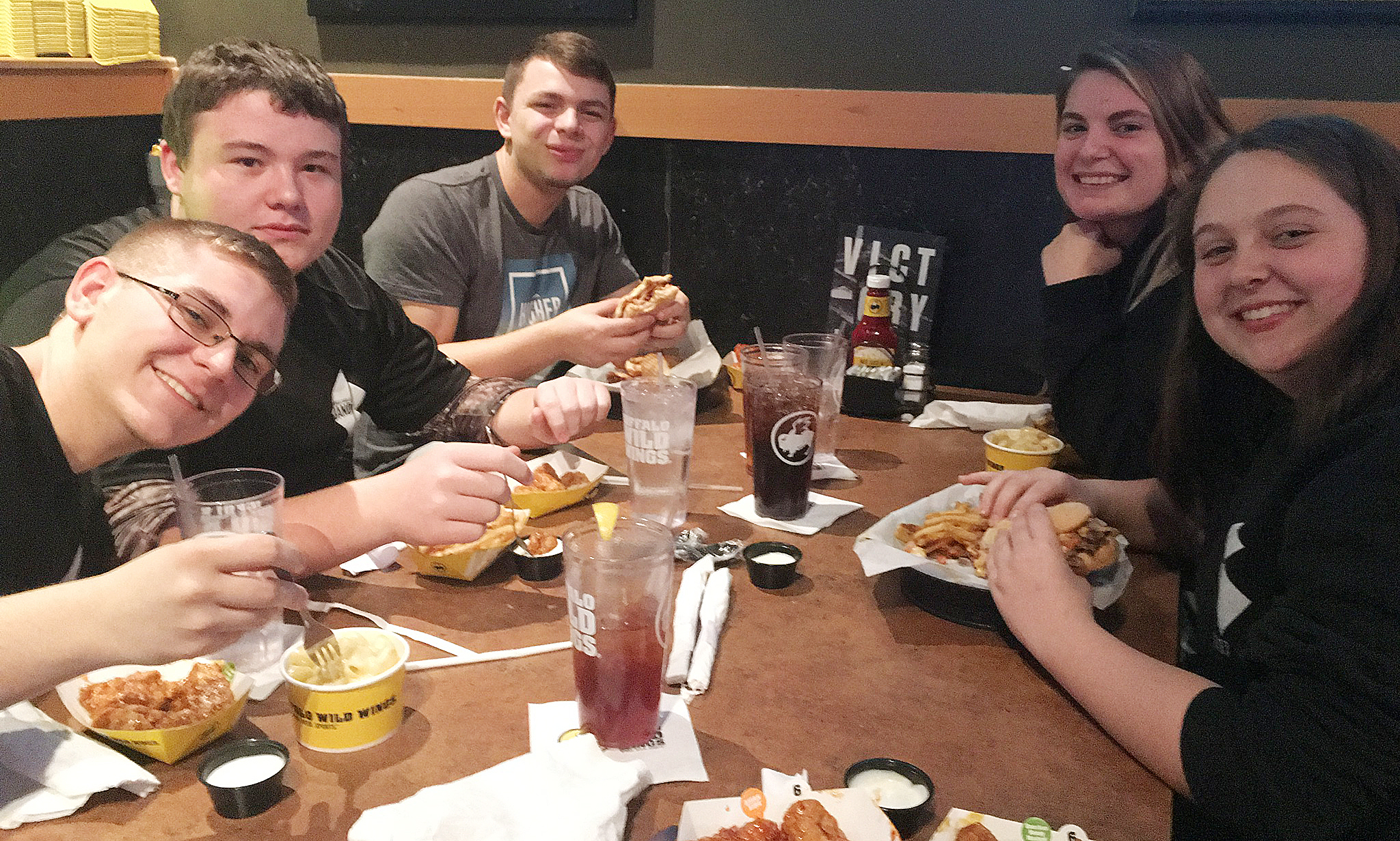 CHS students chosen to participate in the Western Kentucky University Honors Band Clinic take a dinner break. From left are junior Brandon Greer, sophomore Conner Riley, seniors Chaz Babbs and Tiffany Kane and junior Ruby Hatfield.