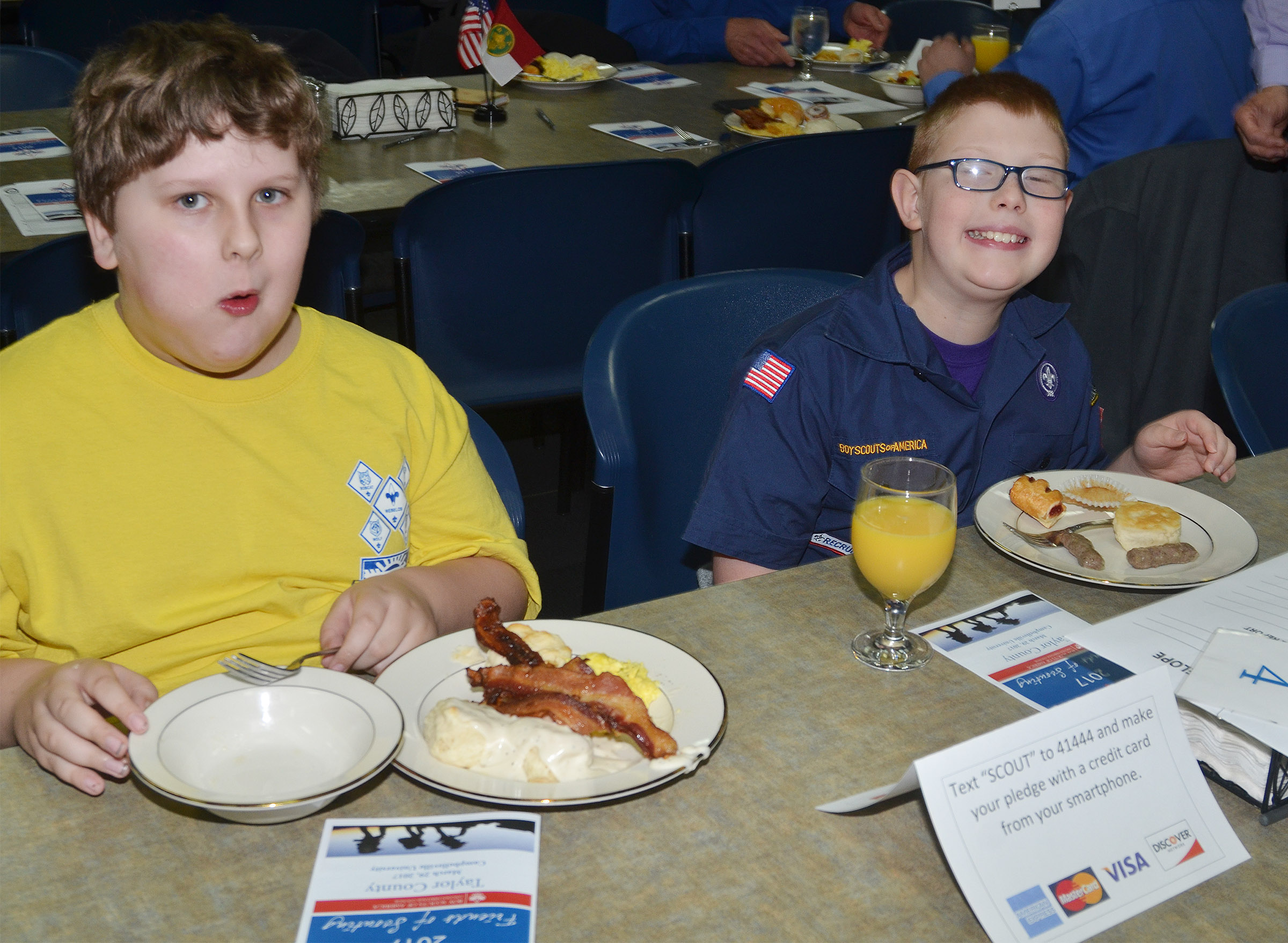 Campbellsville Middle School fourth-grader Zeke Harris, at left, and Campbellsville Elementary School third-grader Aidan Phillips enjoy breakfast.