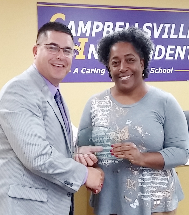 Campbellsville Independent Schools Superintendent Kirby Smith, at left, honors community partner and parent Theresa Young with the community Change Award.