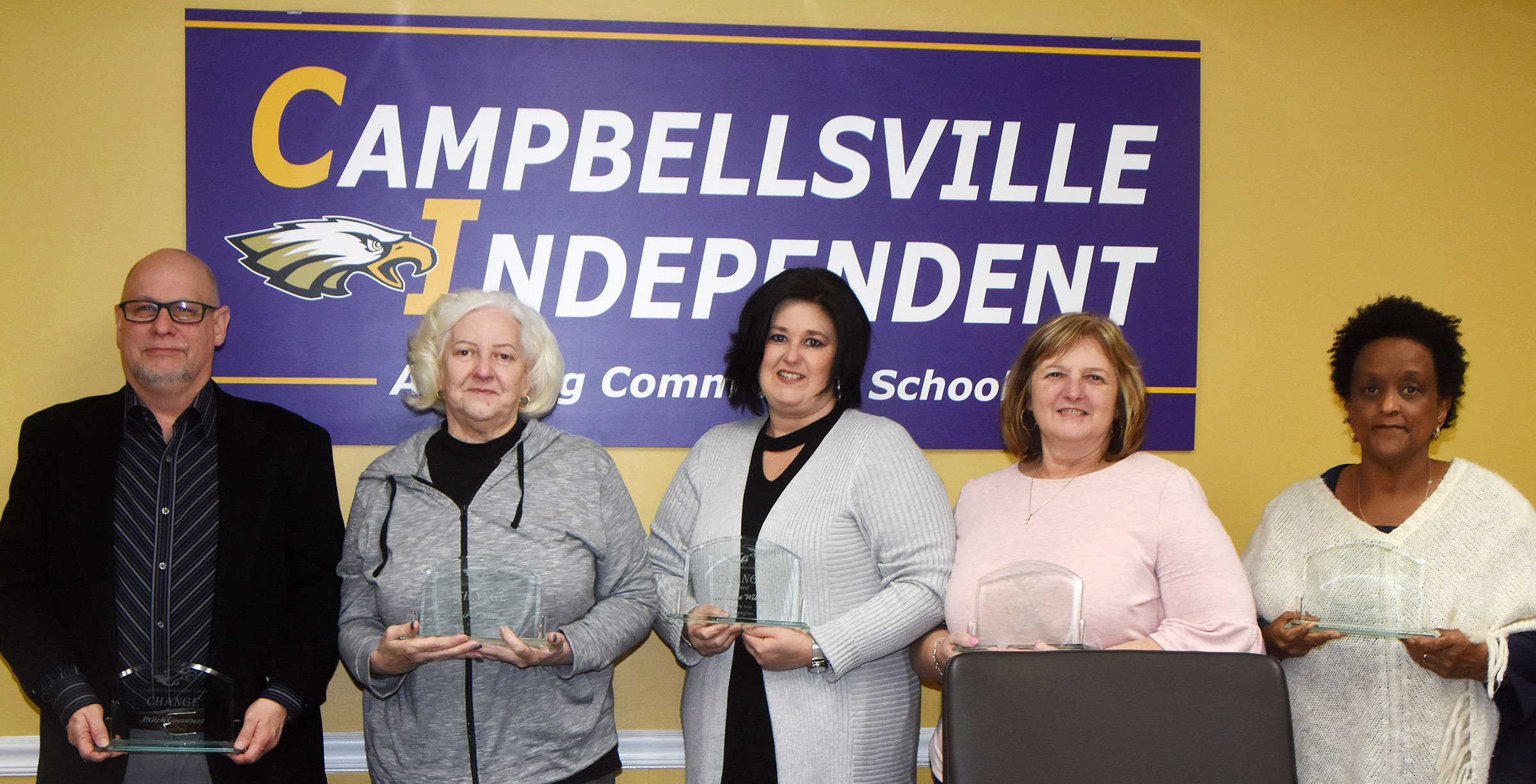 Campbellsville Independent Schools Superintendent Kirby Smith honored Board of Education members with the community Change Award. From left are Board member Mitch Overstreet, Board Chair Pat Hall, Board Vice Chair Suzanne Wilson and Board members Angie Johnson and Barkley Taylor.