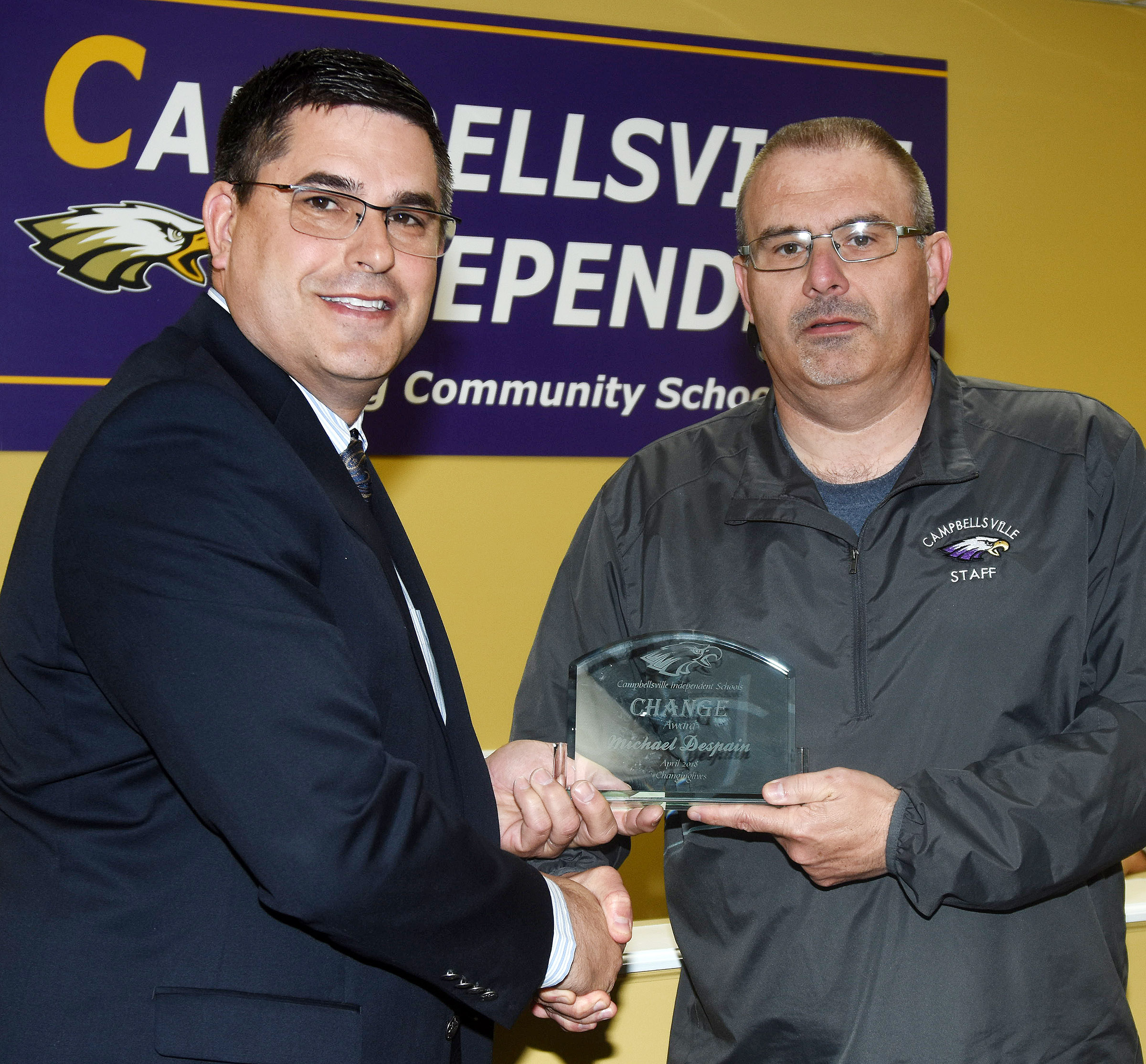 "Campbellsville Independent Schools Superintendent Kirby Smith, at left, honors CMS teacher Michael ""Spanky"" Despain with the certified Change Award."