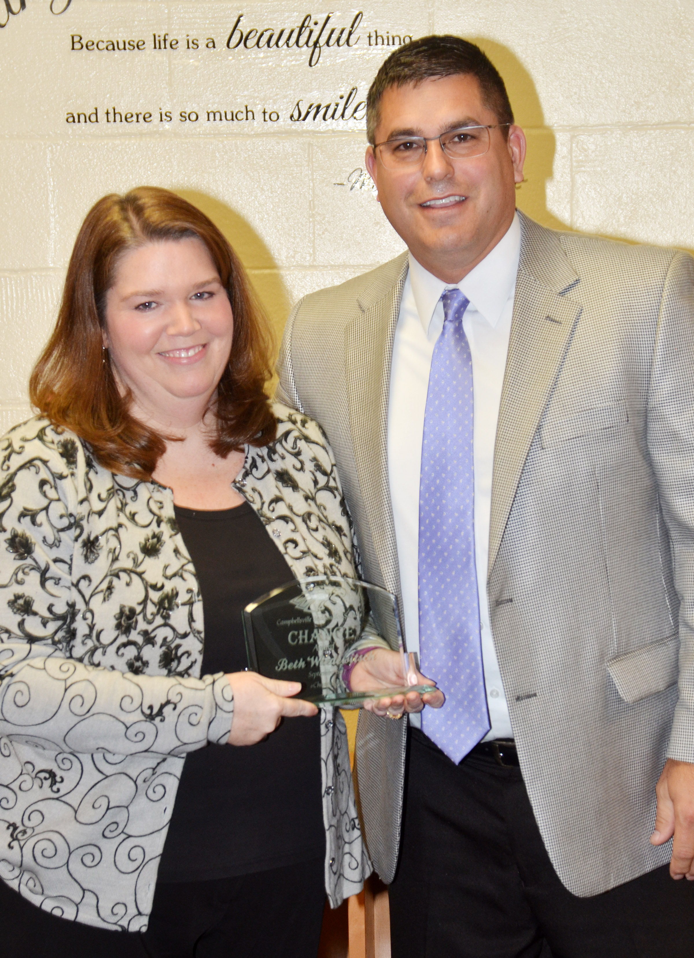 Campbellsville Independent Schools Superintendent Kirby Smith, at right, honors CES/CMS Guidance Counselor Beth Wiedewitsch with the certified Change Award.