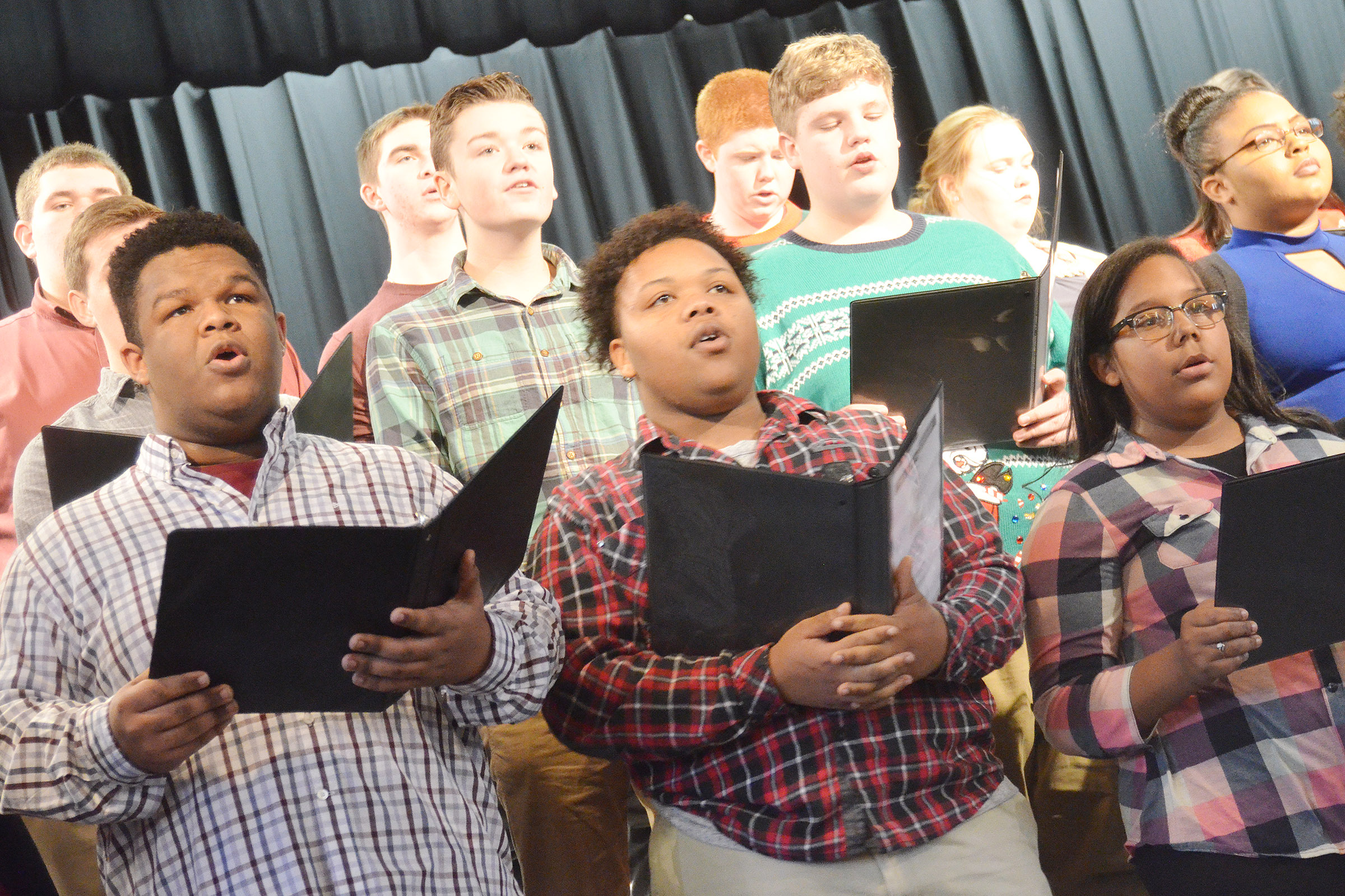 CHS choir members sing. In front, from left, are junior Jeremiah Jackson, senior Darius Wright and sophomore Zaria Cowan.