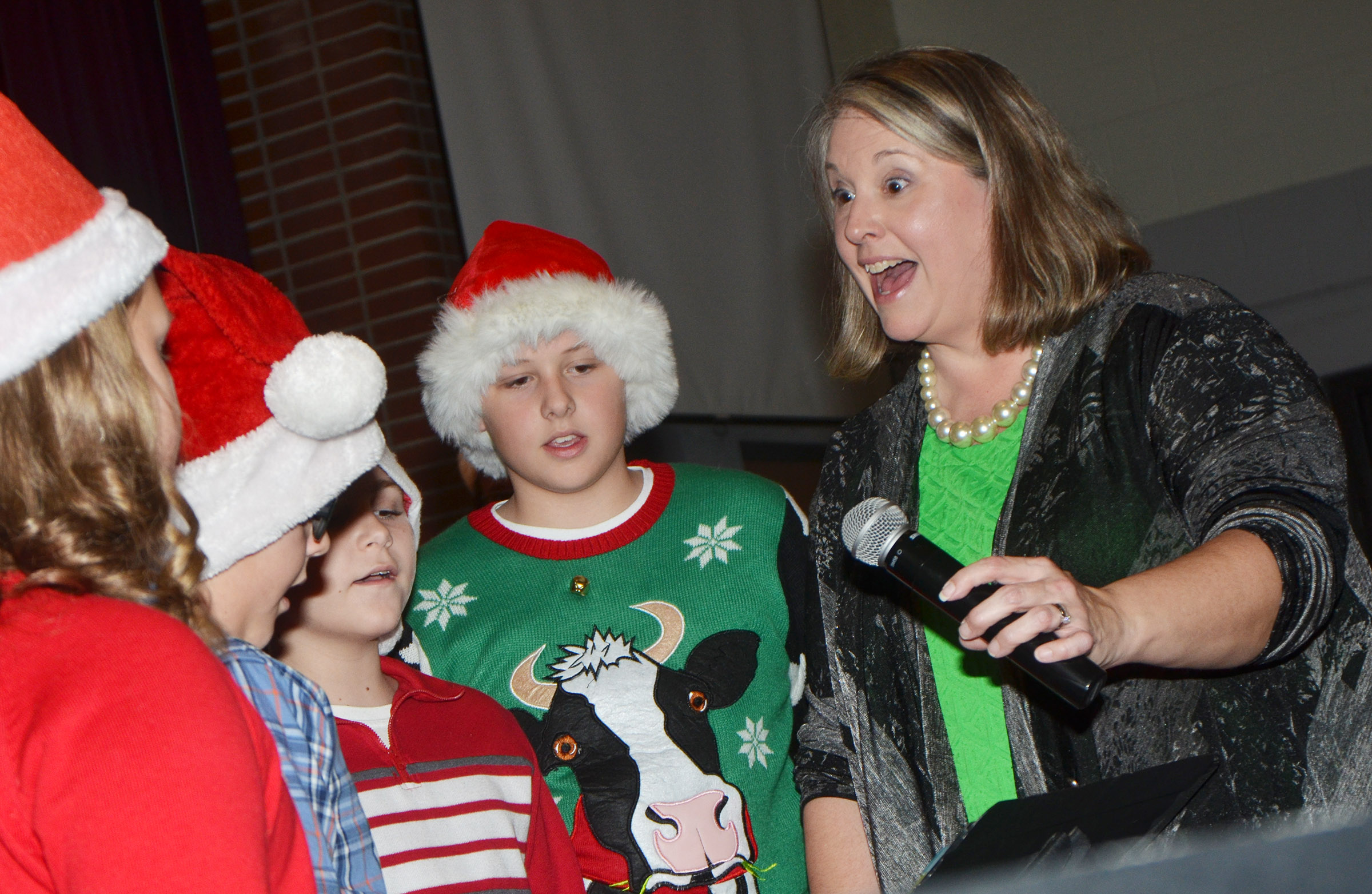 CES choir director Cyndi Chadwick sings with her choir members.