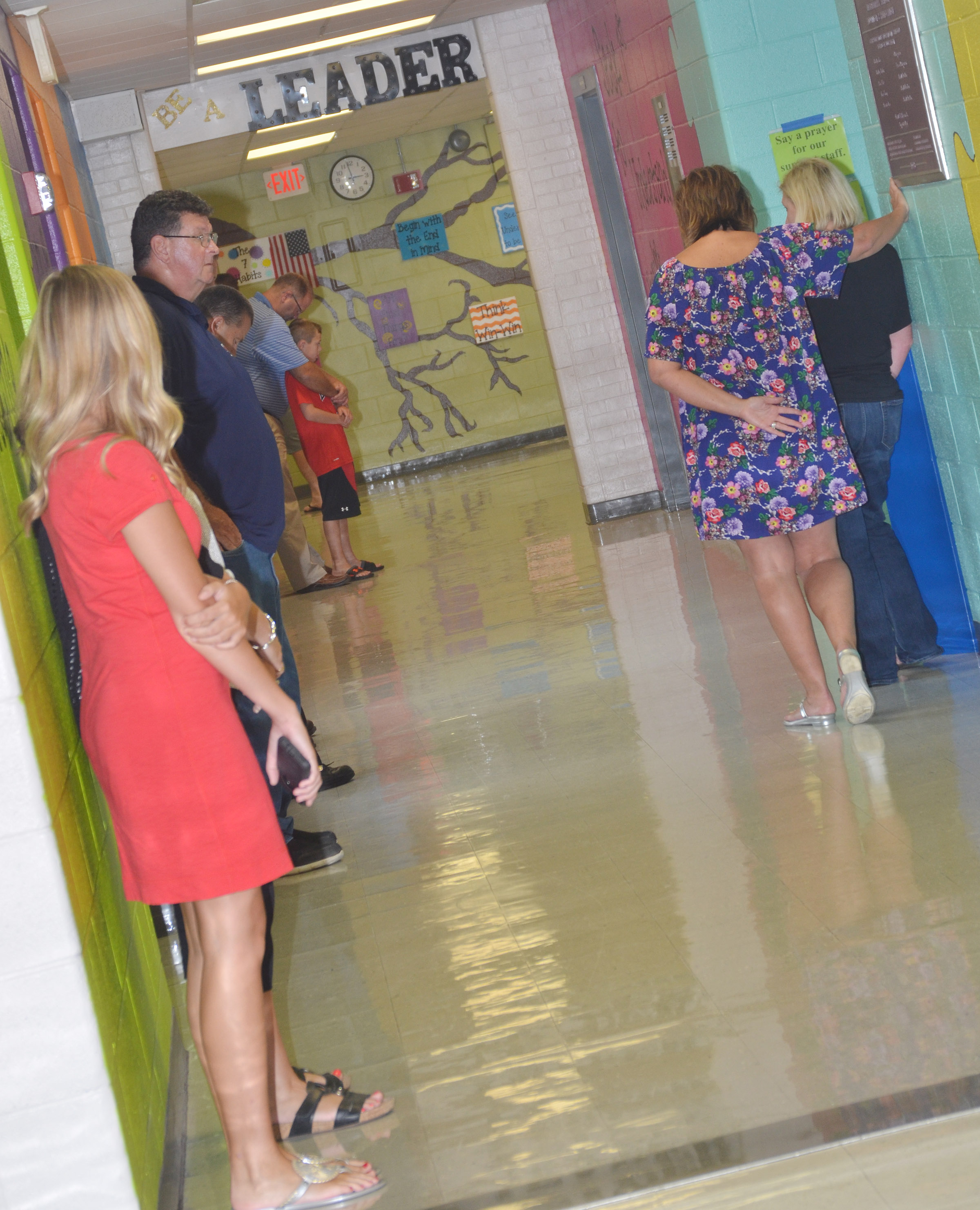 CIS staff members, students and parents pray for the new school year.
