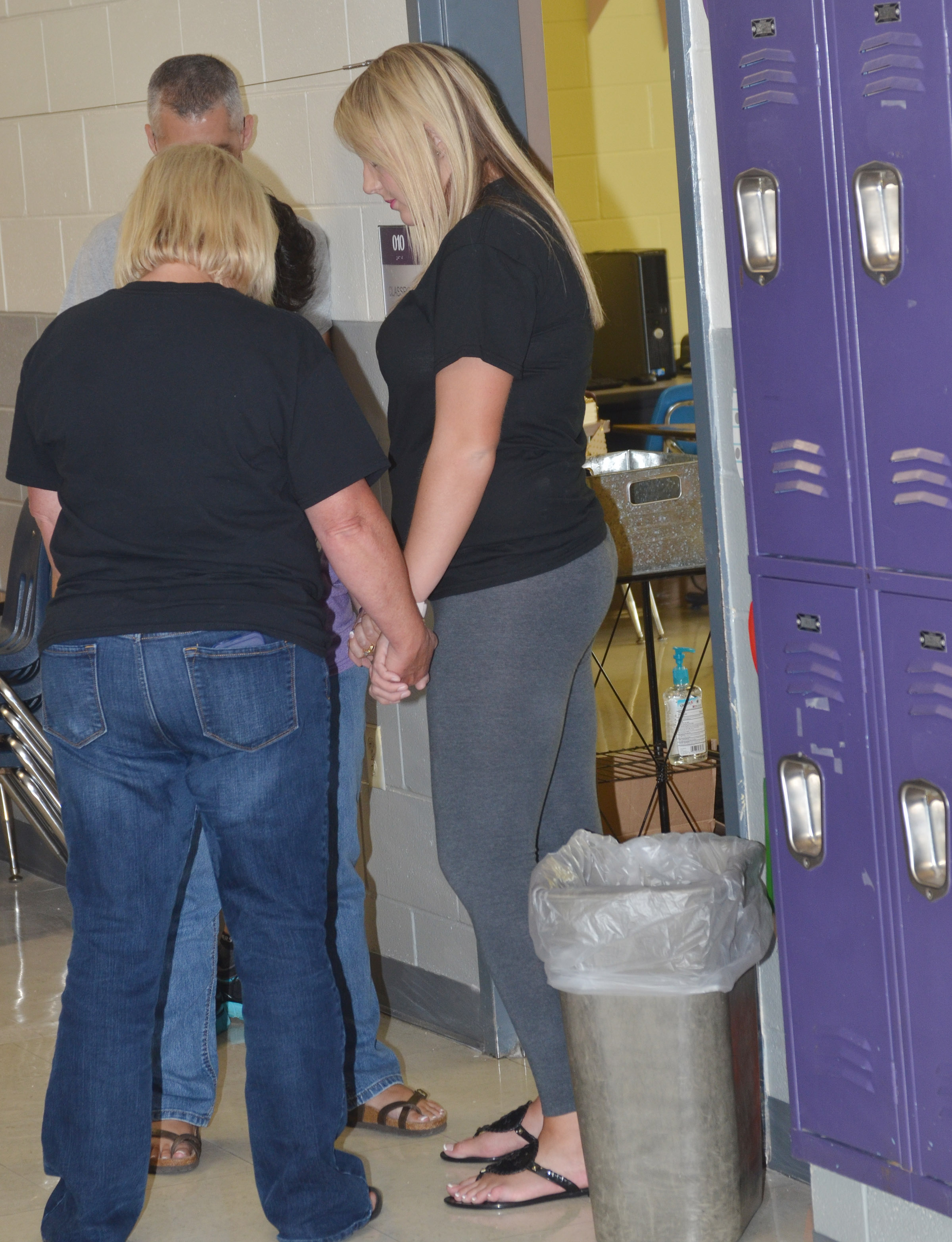 CIS staff members pray with CES third-grade teacher Keri Rowe, at right, who is beginning her first year as a teacher.