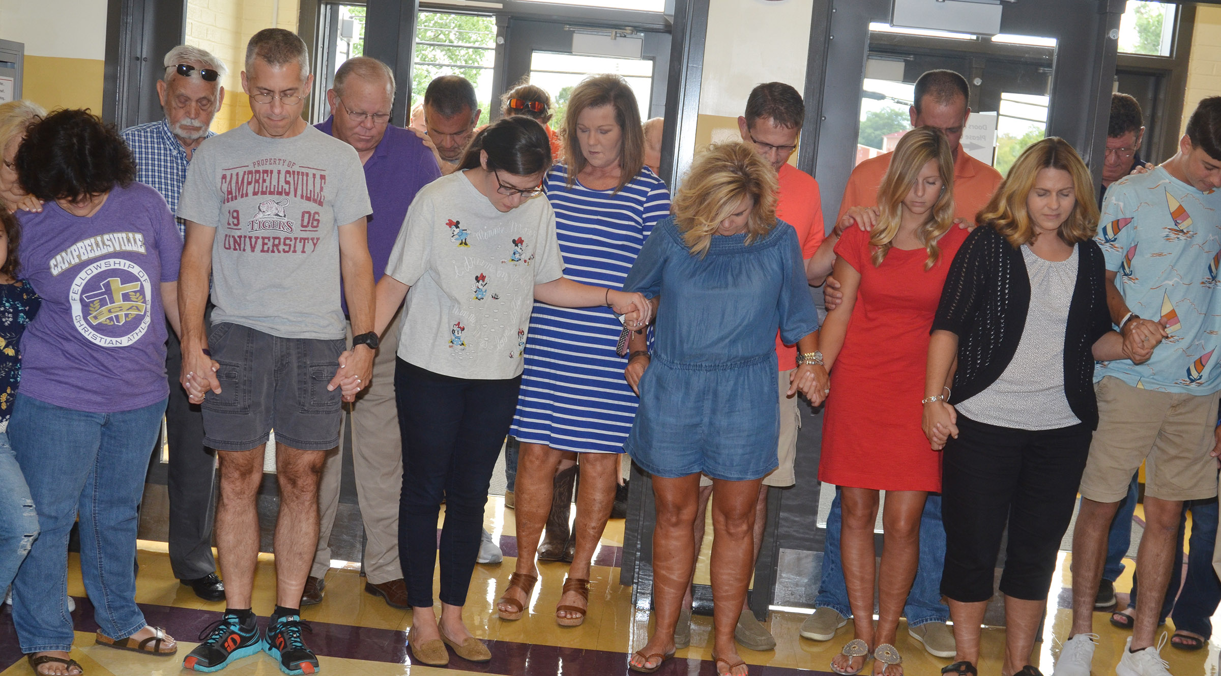 CIS staff members and parents pray for the new school year.