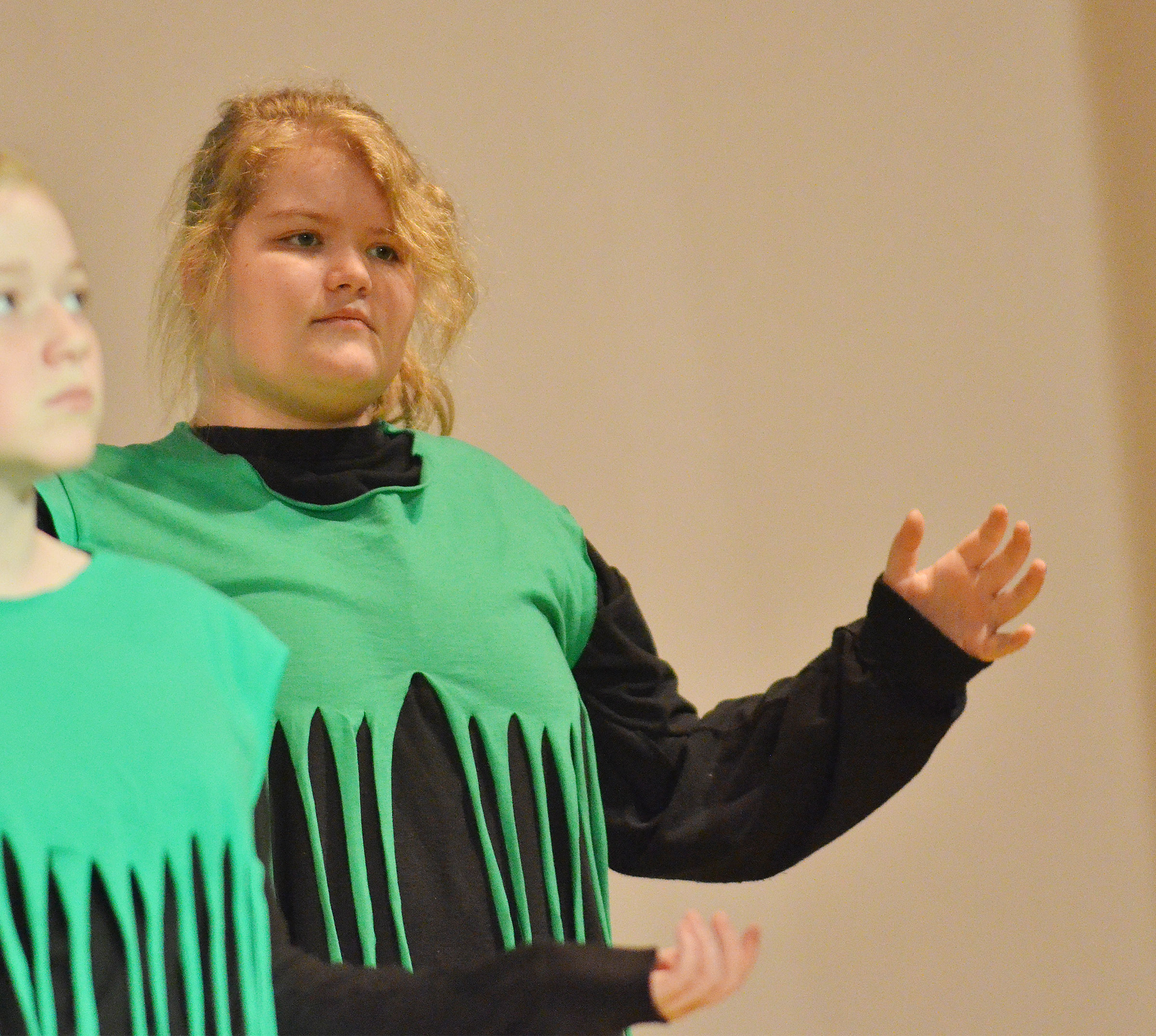 CMS sixth-grader Aubrey Young portrays a house piece, apple tree and scary tree.