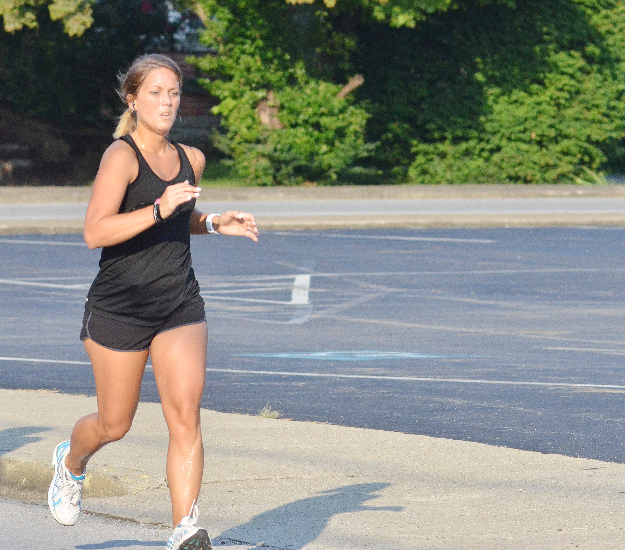 Campbellsville Middle School bookkeeper Natalia Warren finishes the 5K race.
