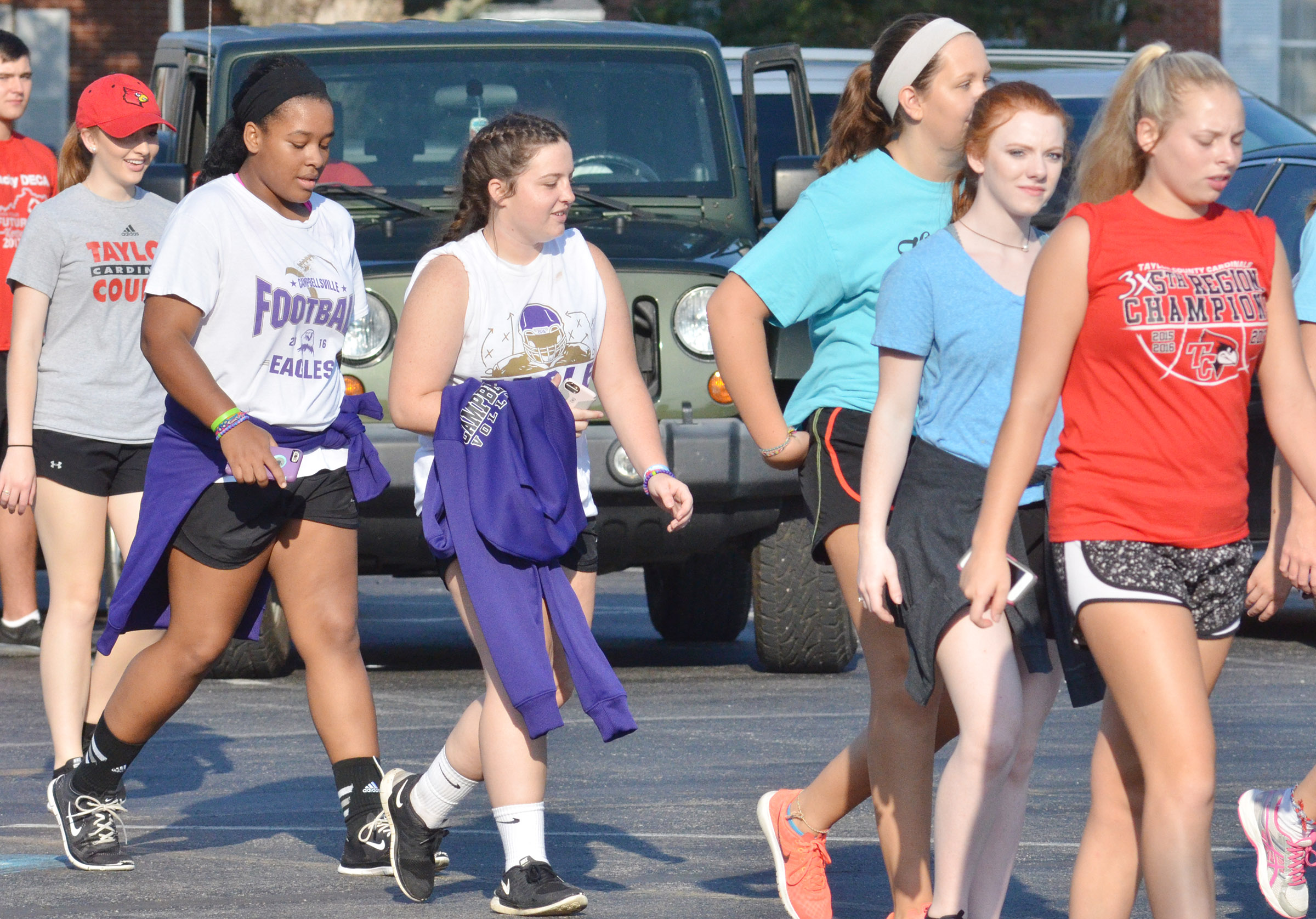 CHS seniors Kayla Young, second from left, and Caitlin Bright, third from left, finish the 5K race.