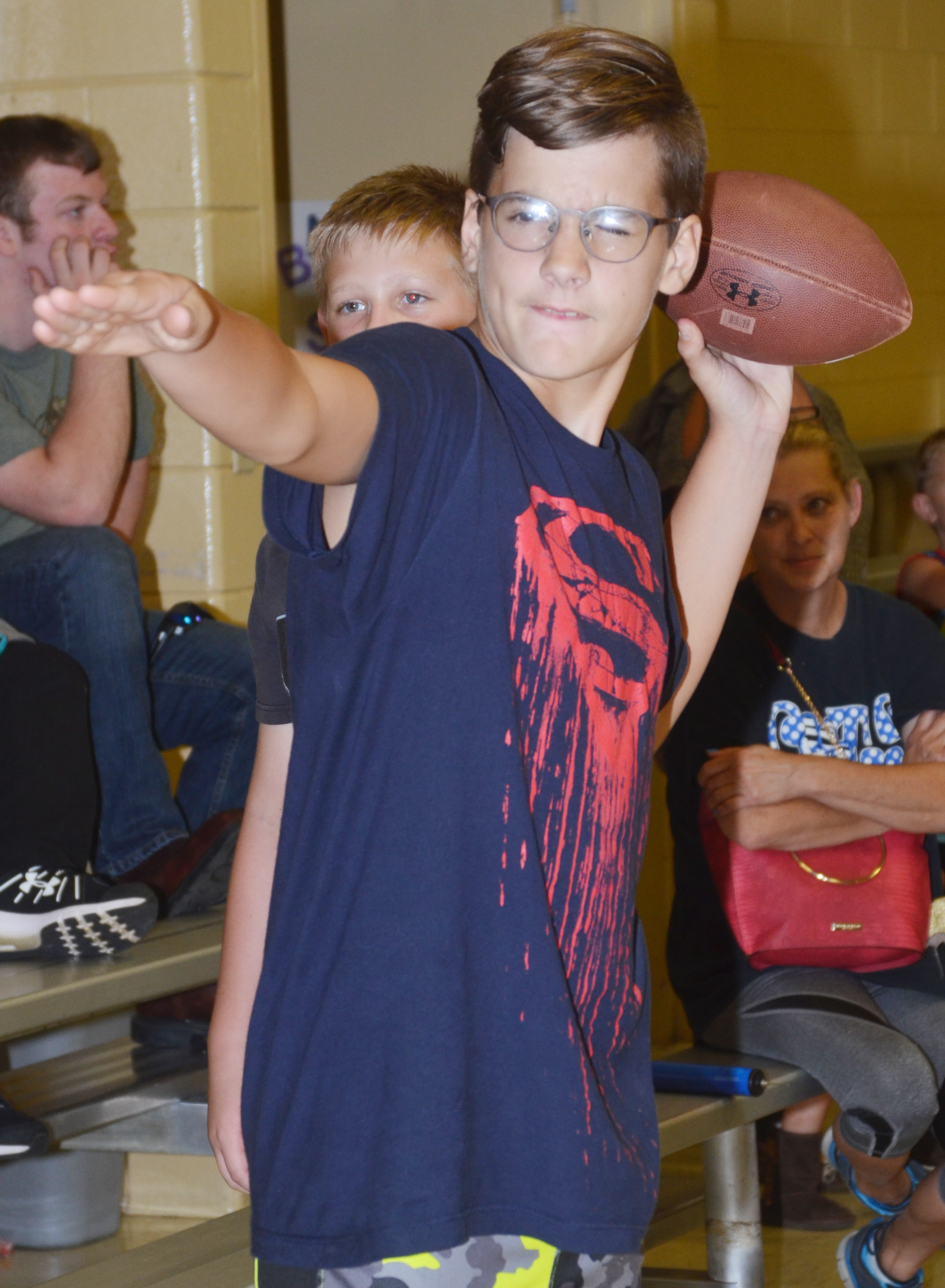 CMS sixth-grader Dalton Morris throws a football.