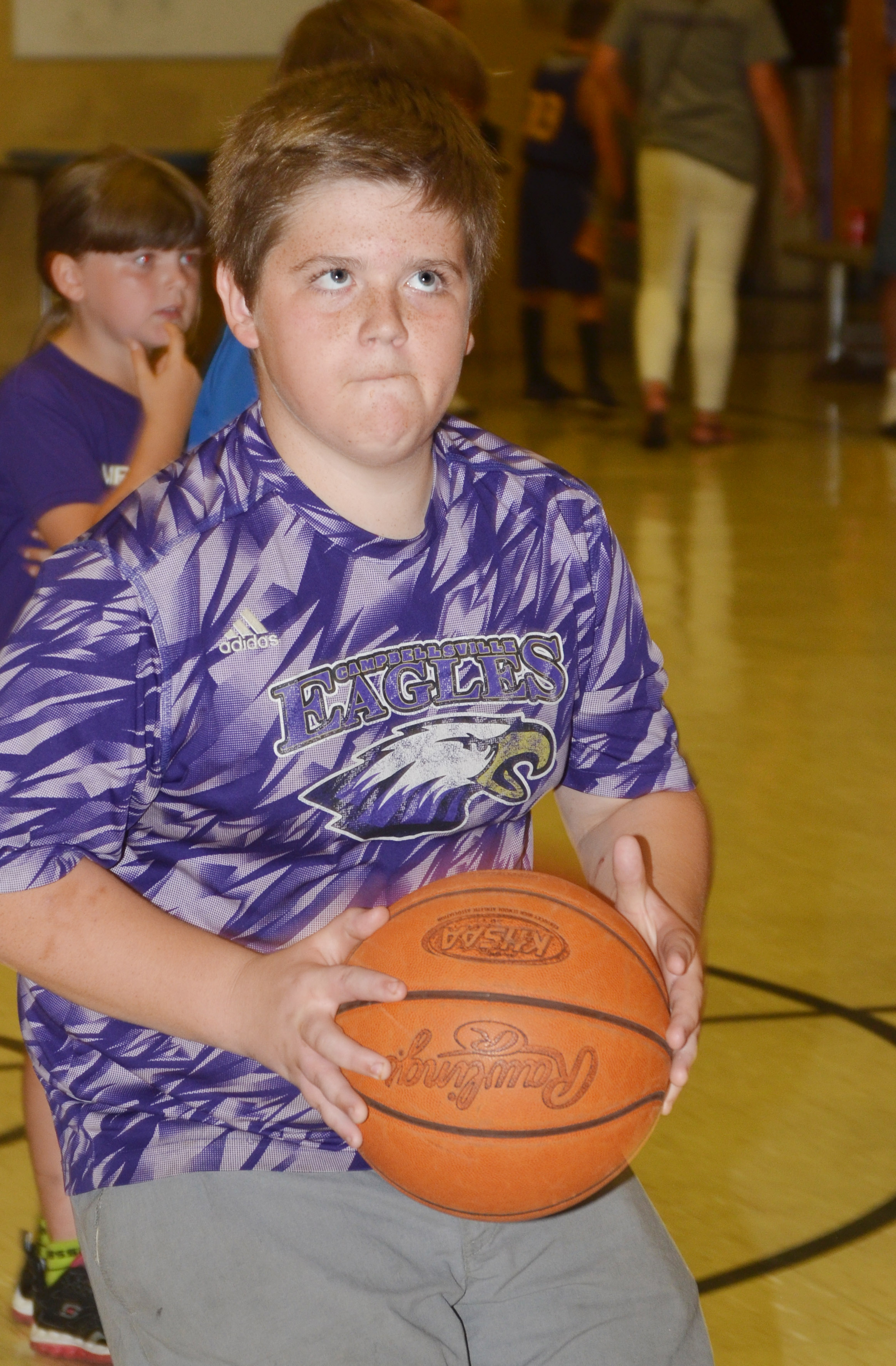 CMS eighth-grader Zachery Underwood shoots a basketball.