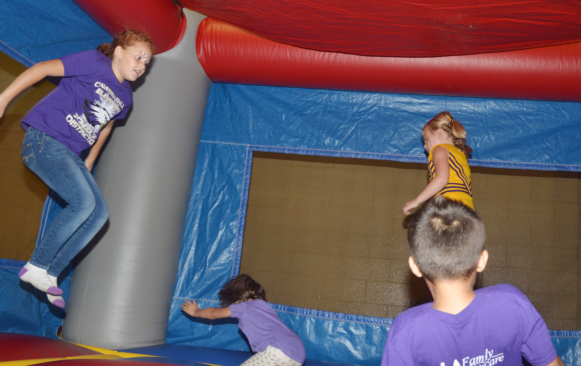 CES third-grader Analeigh Foster and her friends jump.