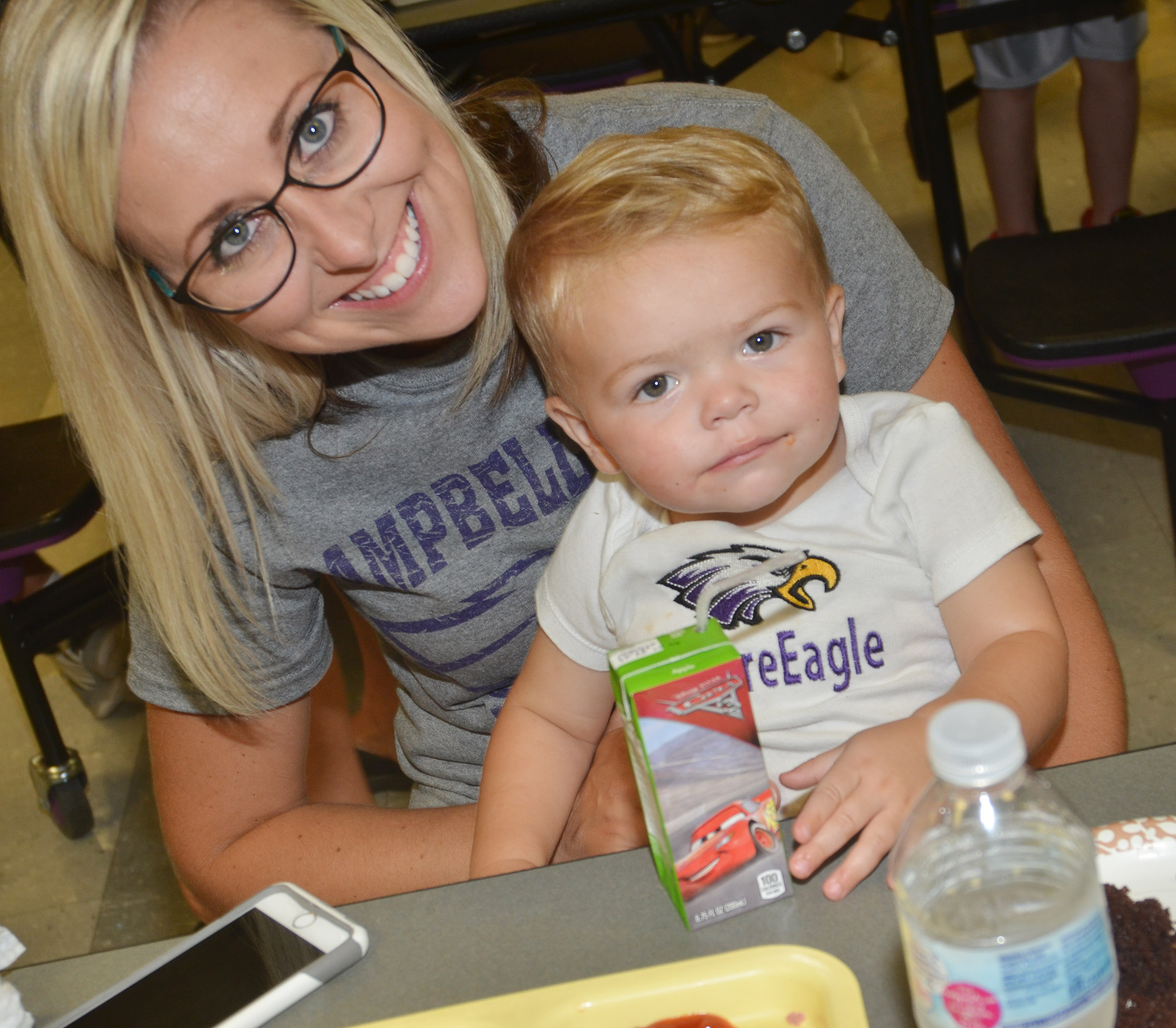CES teacher Hannah Jones eats chili with her son Grady.