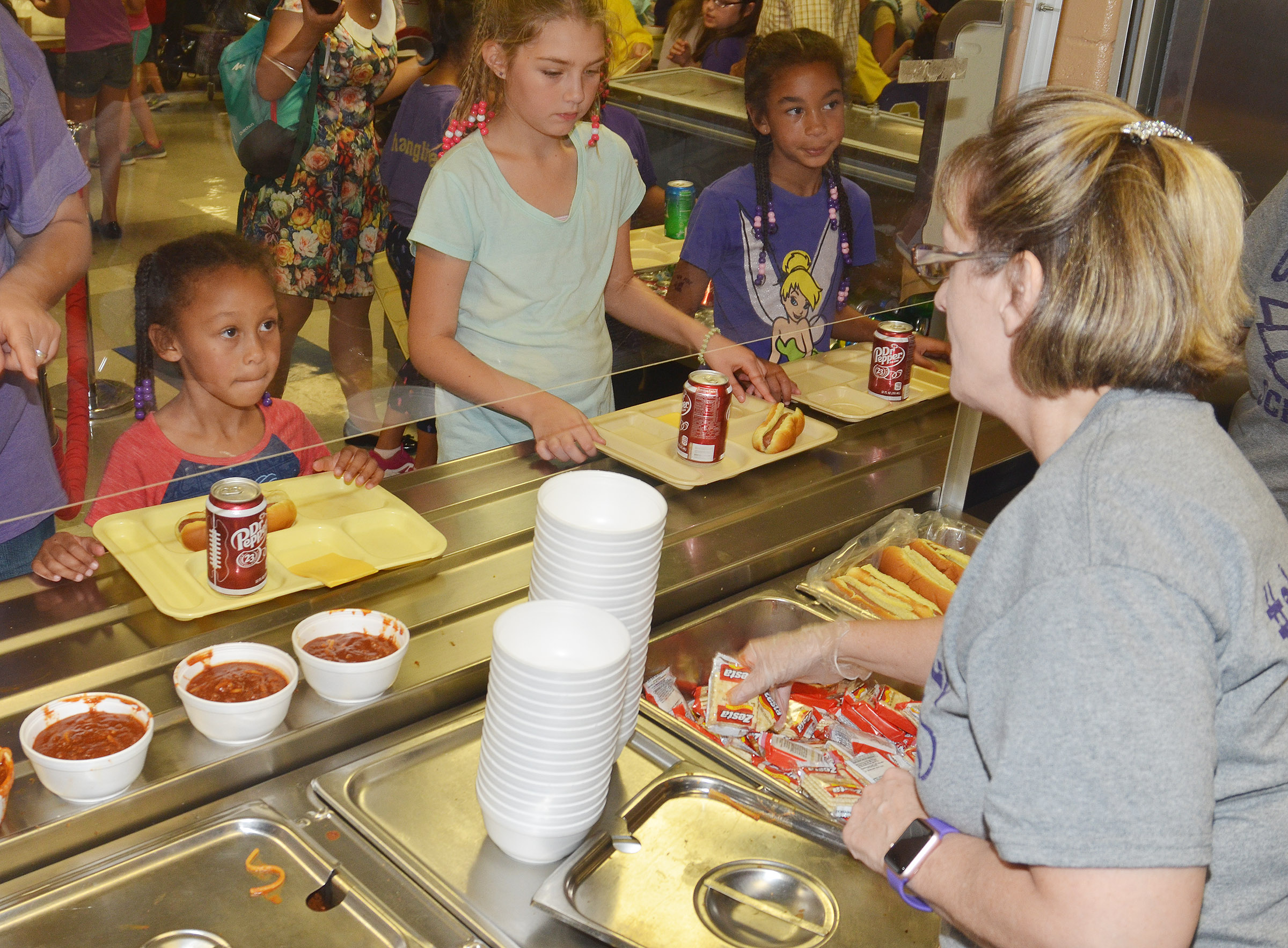CHS teacher Juanita Young serves chili.