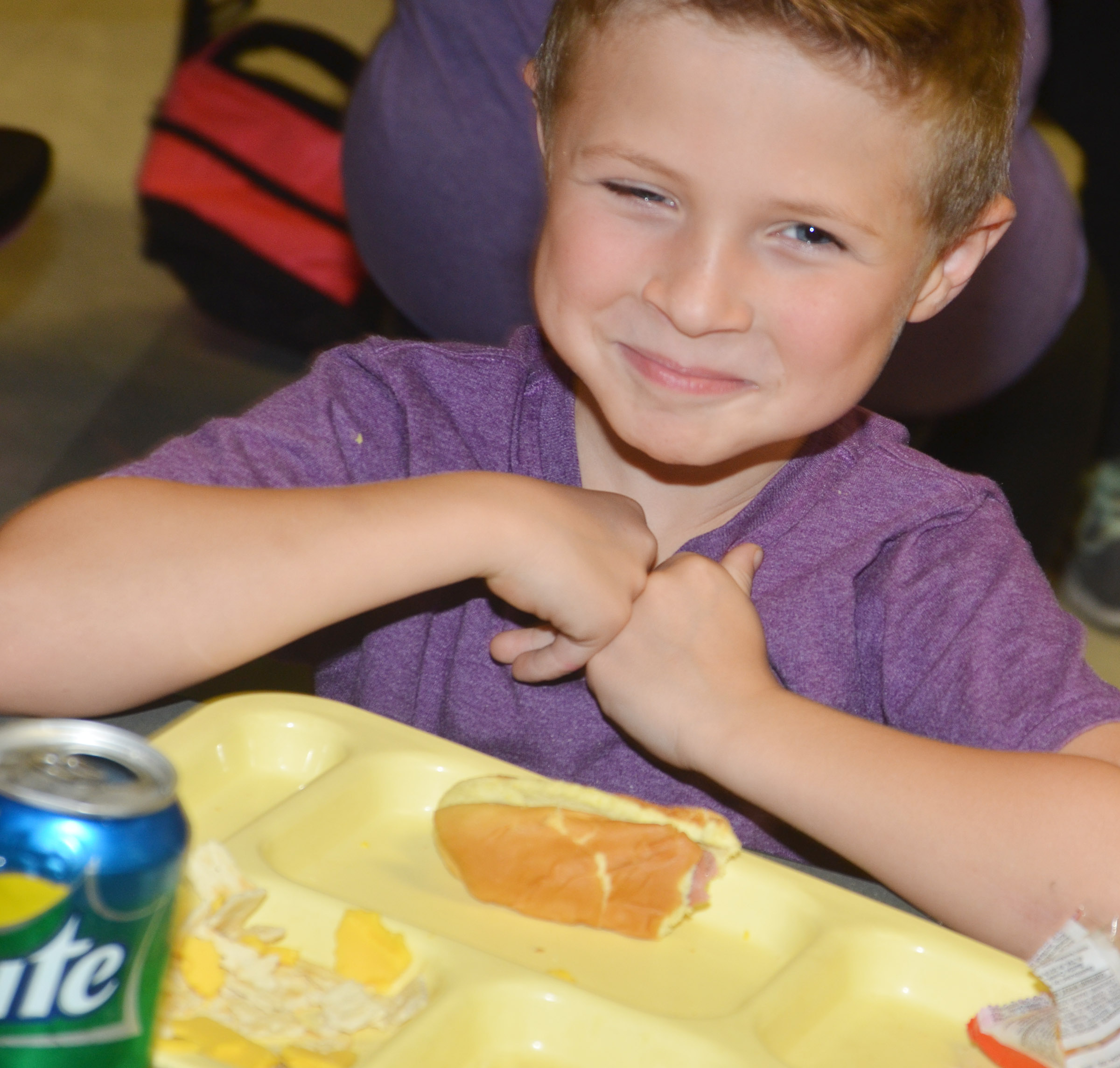 CES second-grader Bryson Gabehart enjoys a hot dog.