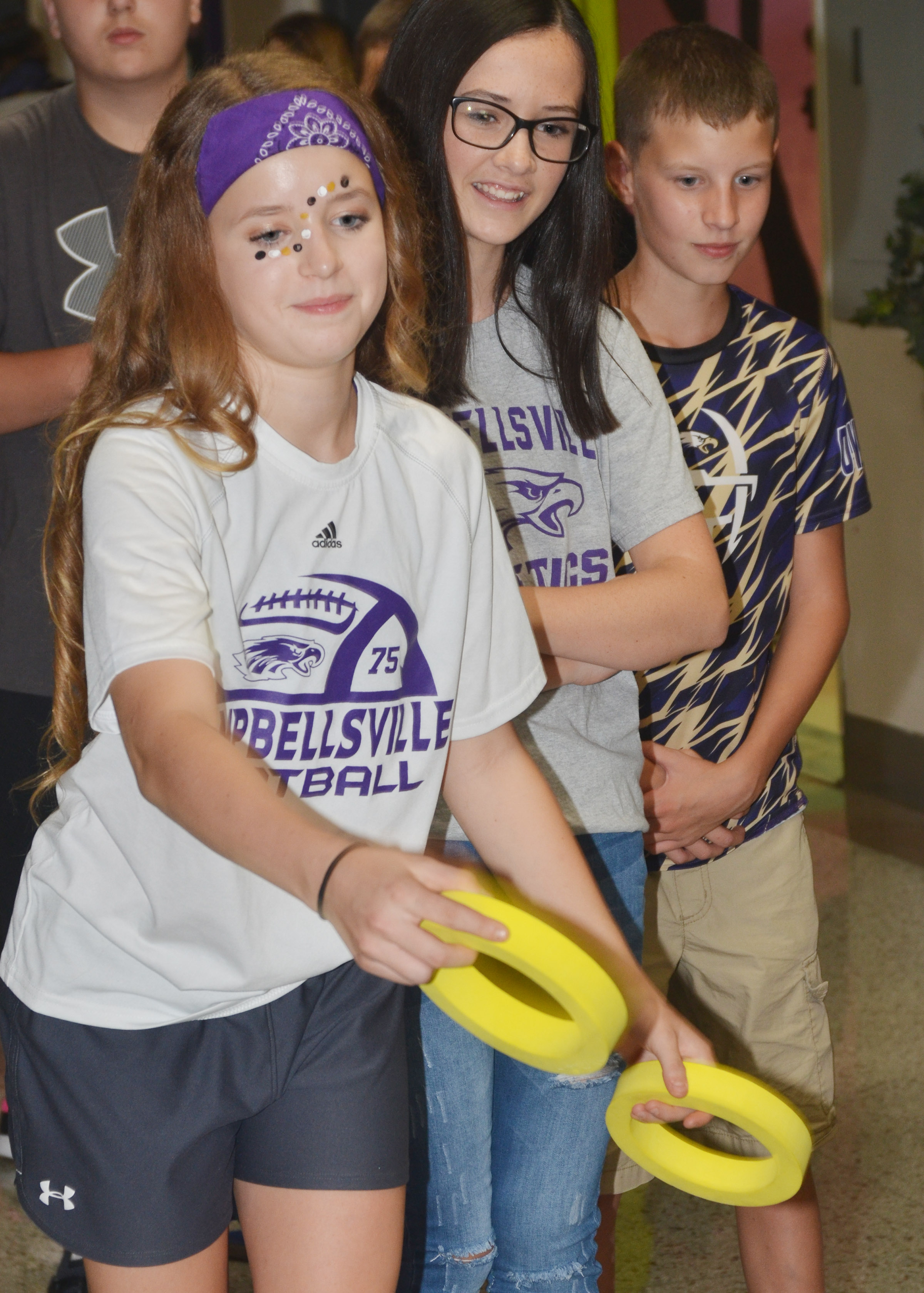 CMS eighth-grader Rylee Petett plays the ring toss.