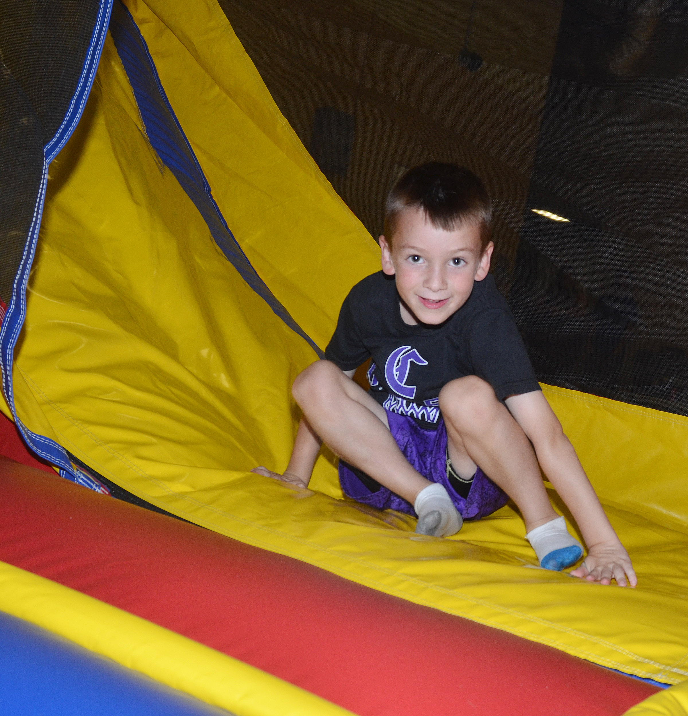 CES kindergartener Cash Davis slides down the slide.