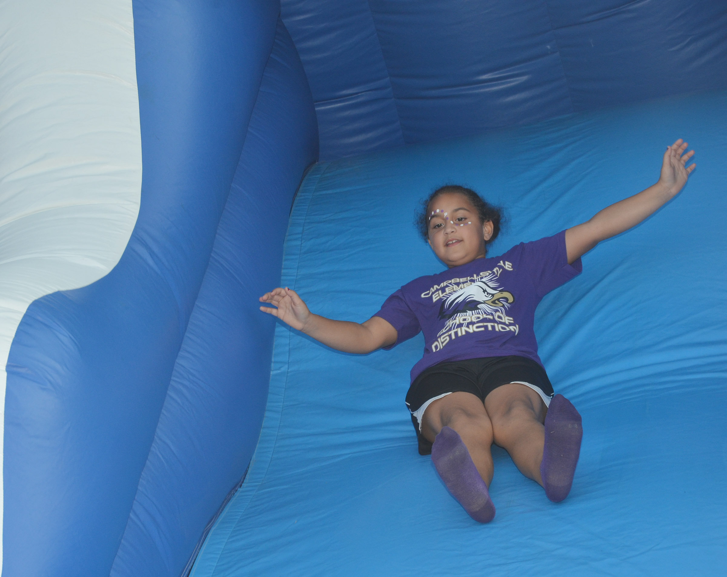 CES second-grader Maleigha Travis slides.
