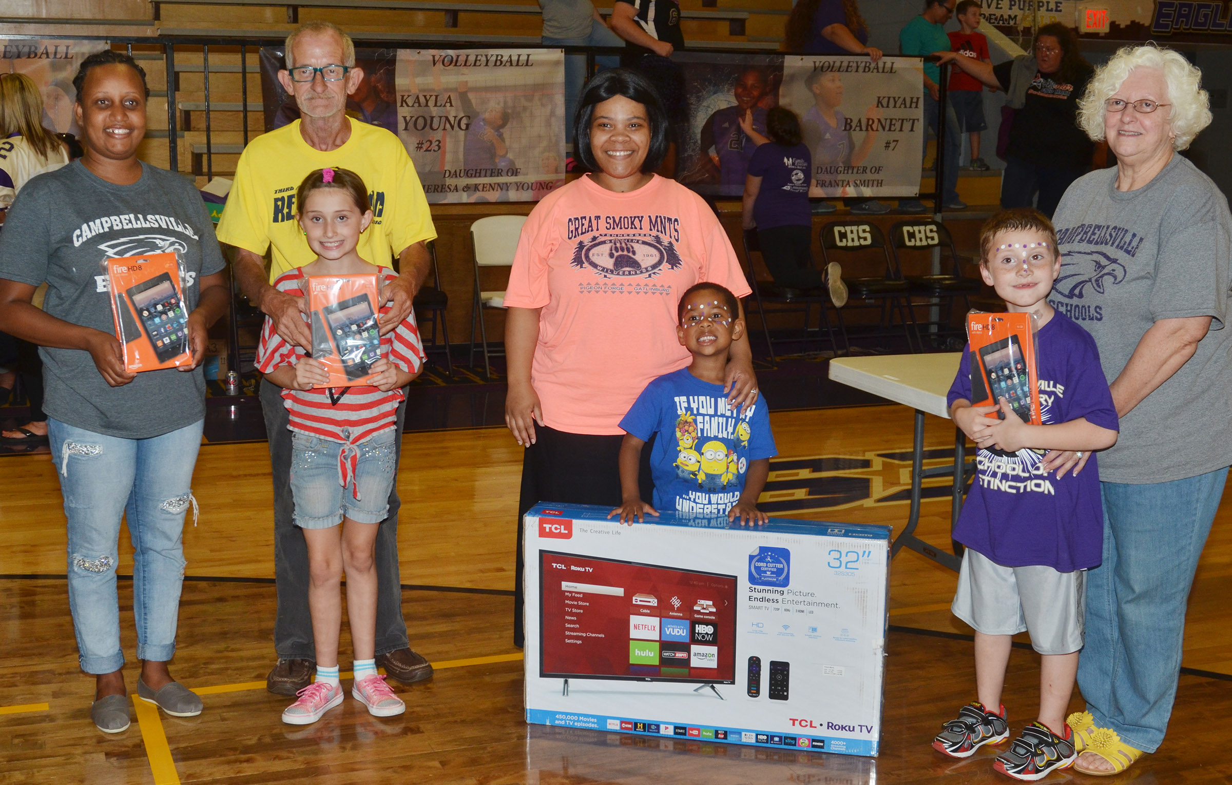 Prize winners are pictured with Board of Education Chair Pat Hall. From left are parent Latanja Taylor, CES third-grader Cadence Burton and her grandfather Robert, parent Anna Noyola and her son and second-grader James Brunner.