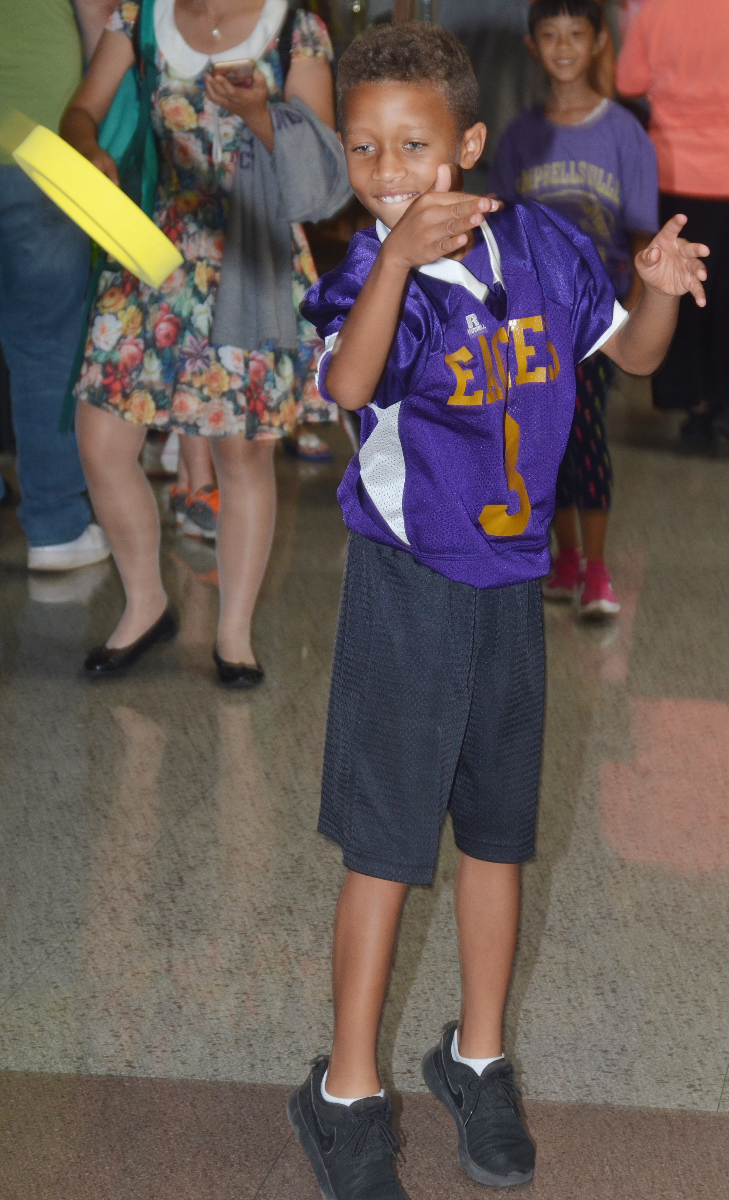 CES third-grader Rajon Taylor plays the ring toss.