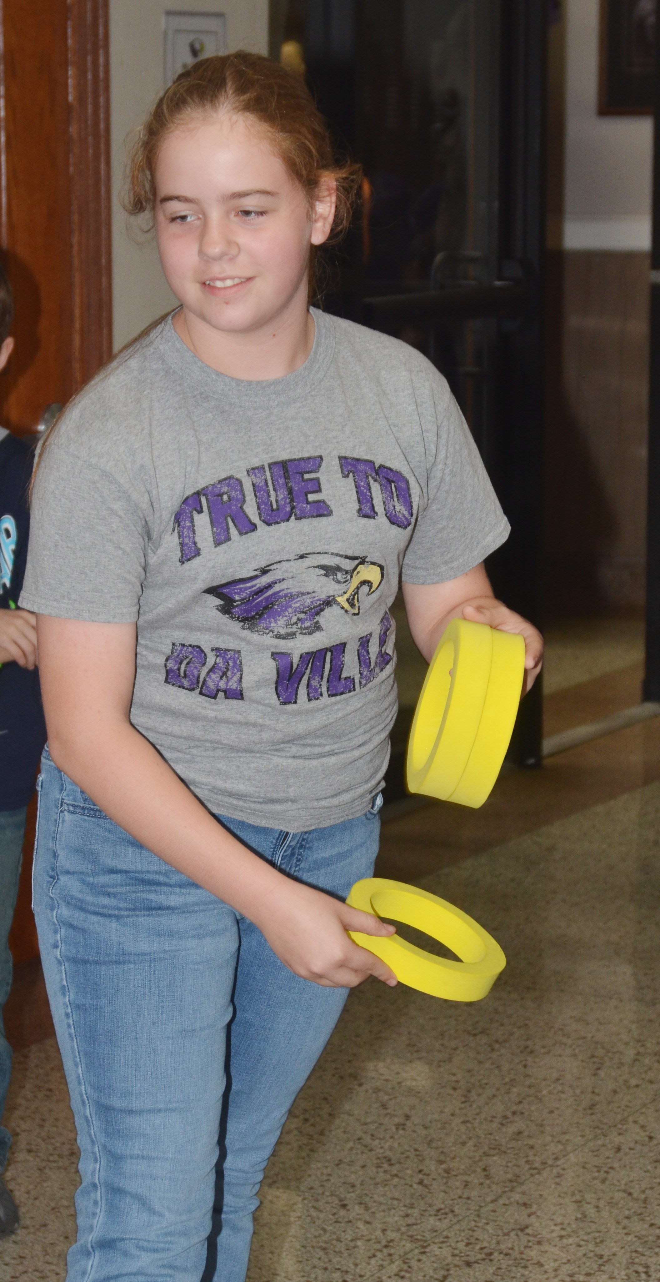 CMS sixth-grader Layla Steen plays the ring toss.