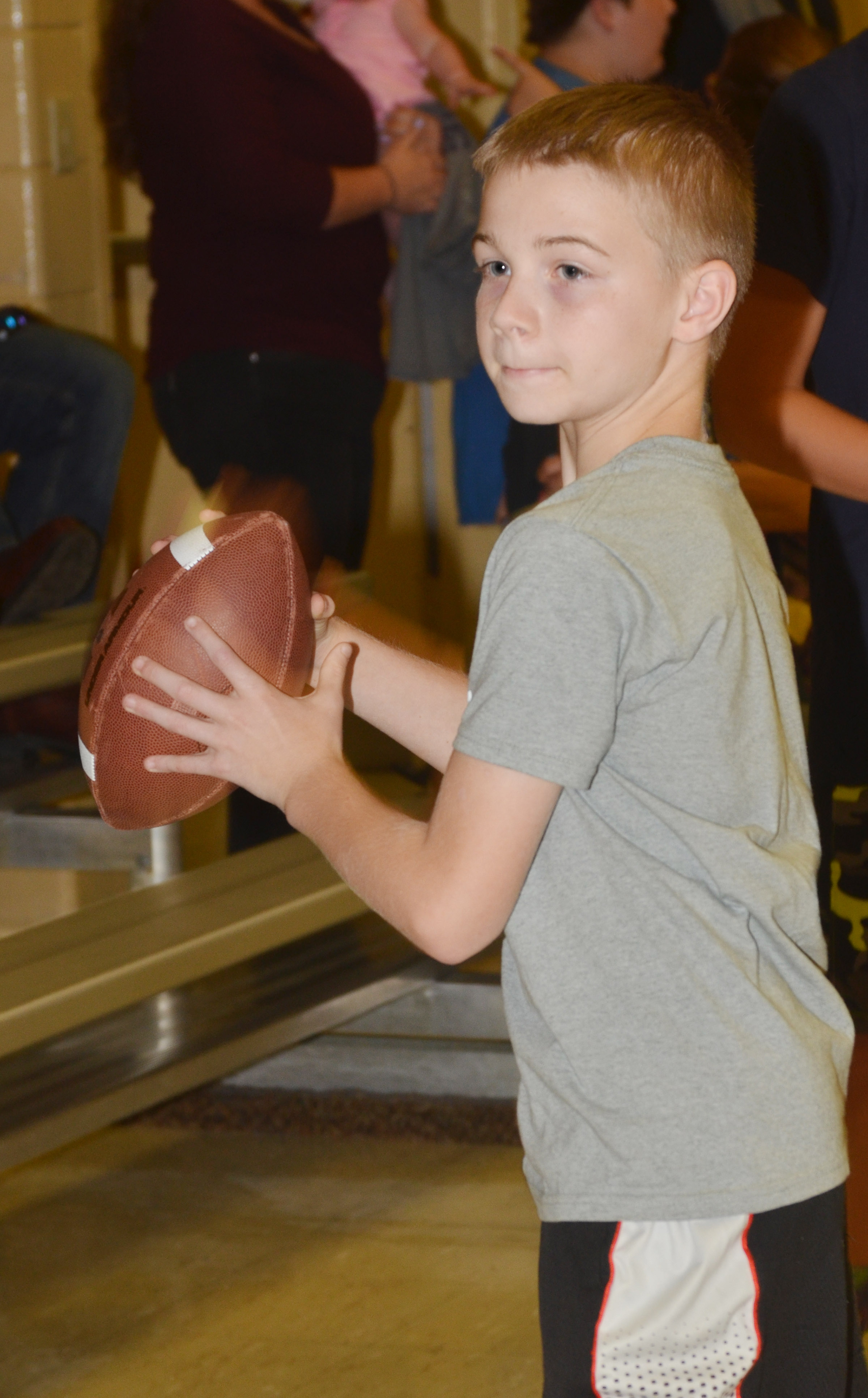 CMS sixth-grader Ethan Cox throws a football.