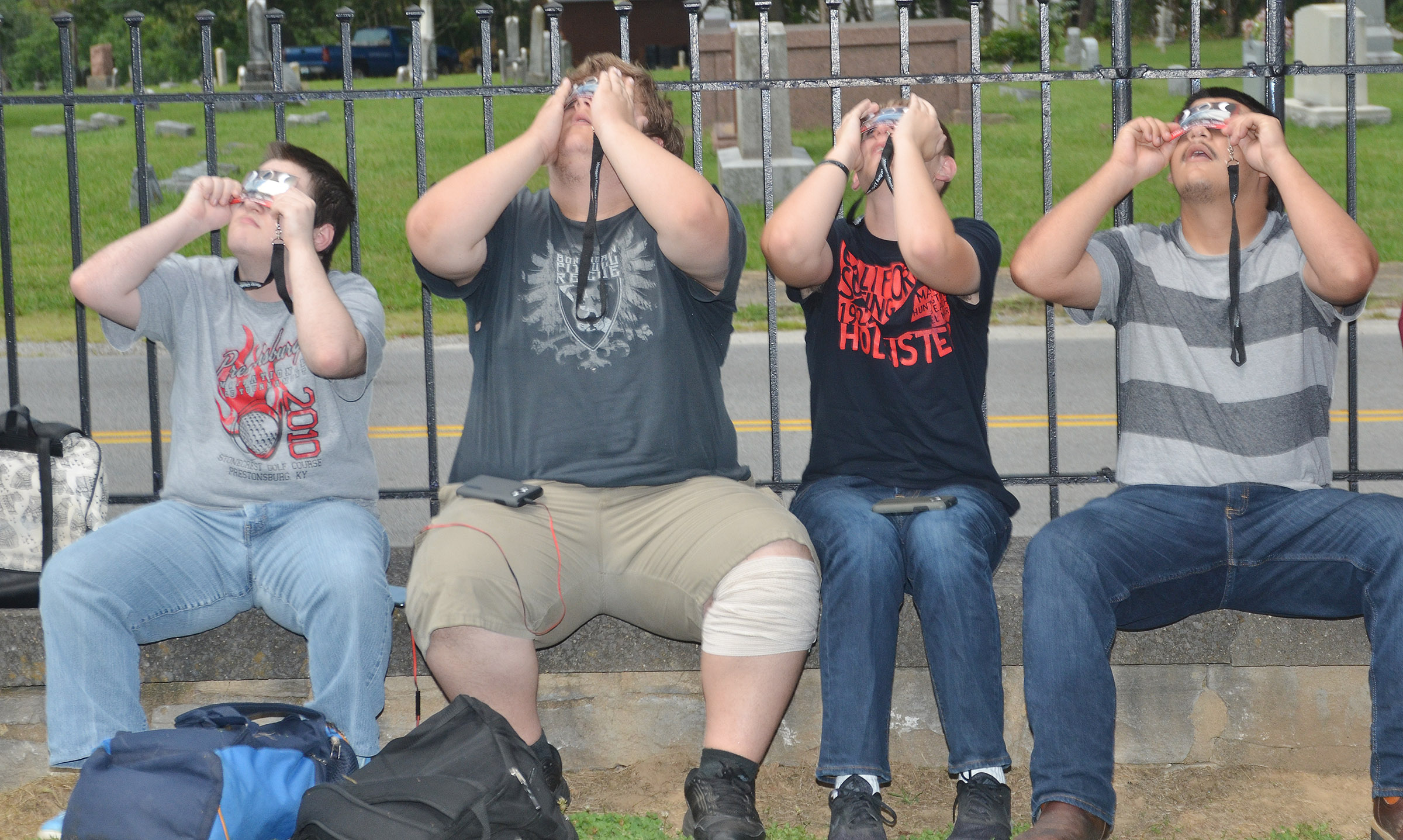 From left, CHS juniors Jim Jefferies, Randy Harris, Brandon Greer and Nick Cowan view the eclipse.