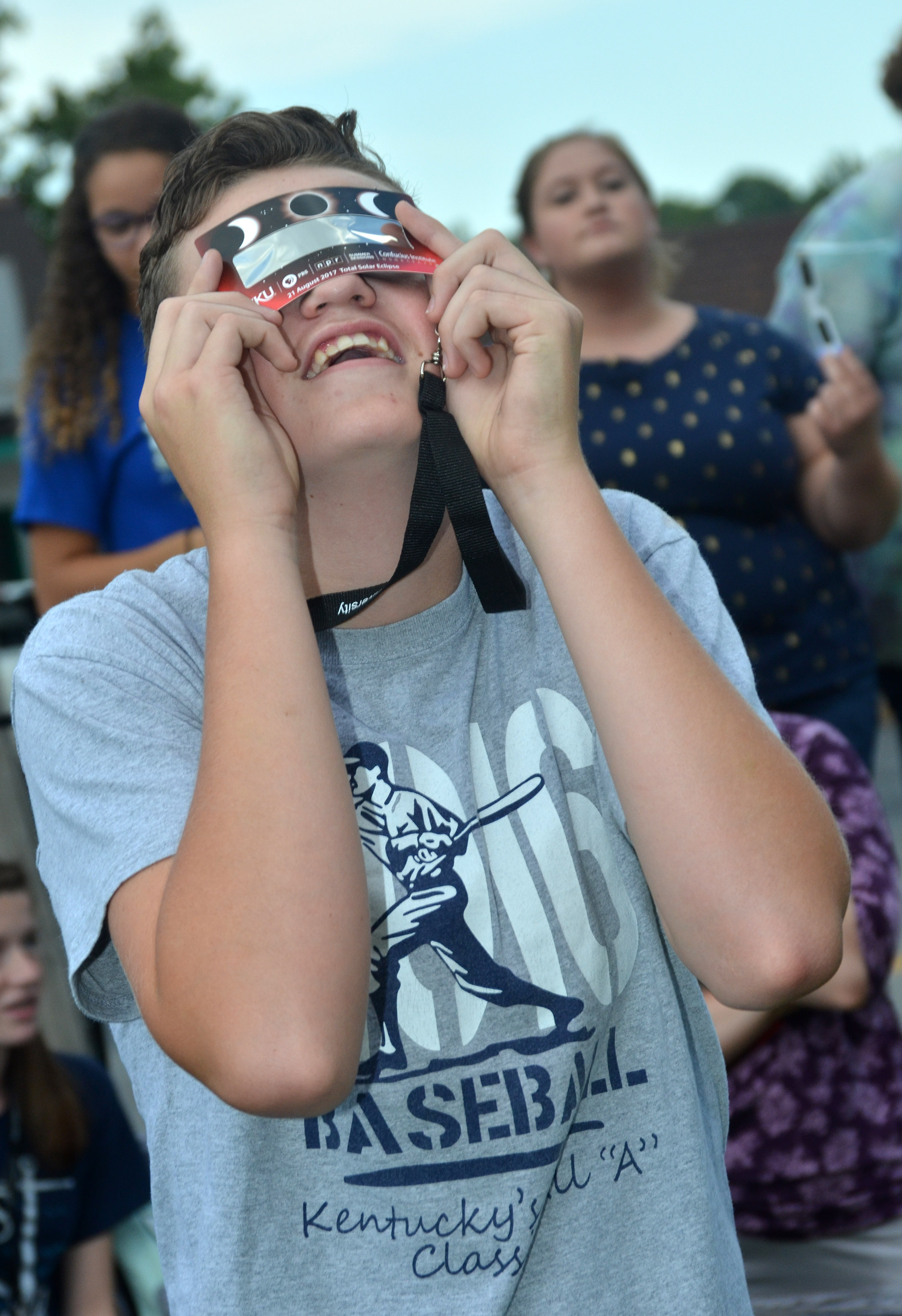 CHS sophomore Gavin Johnson views the eclipse.