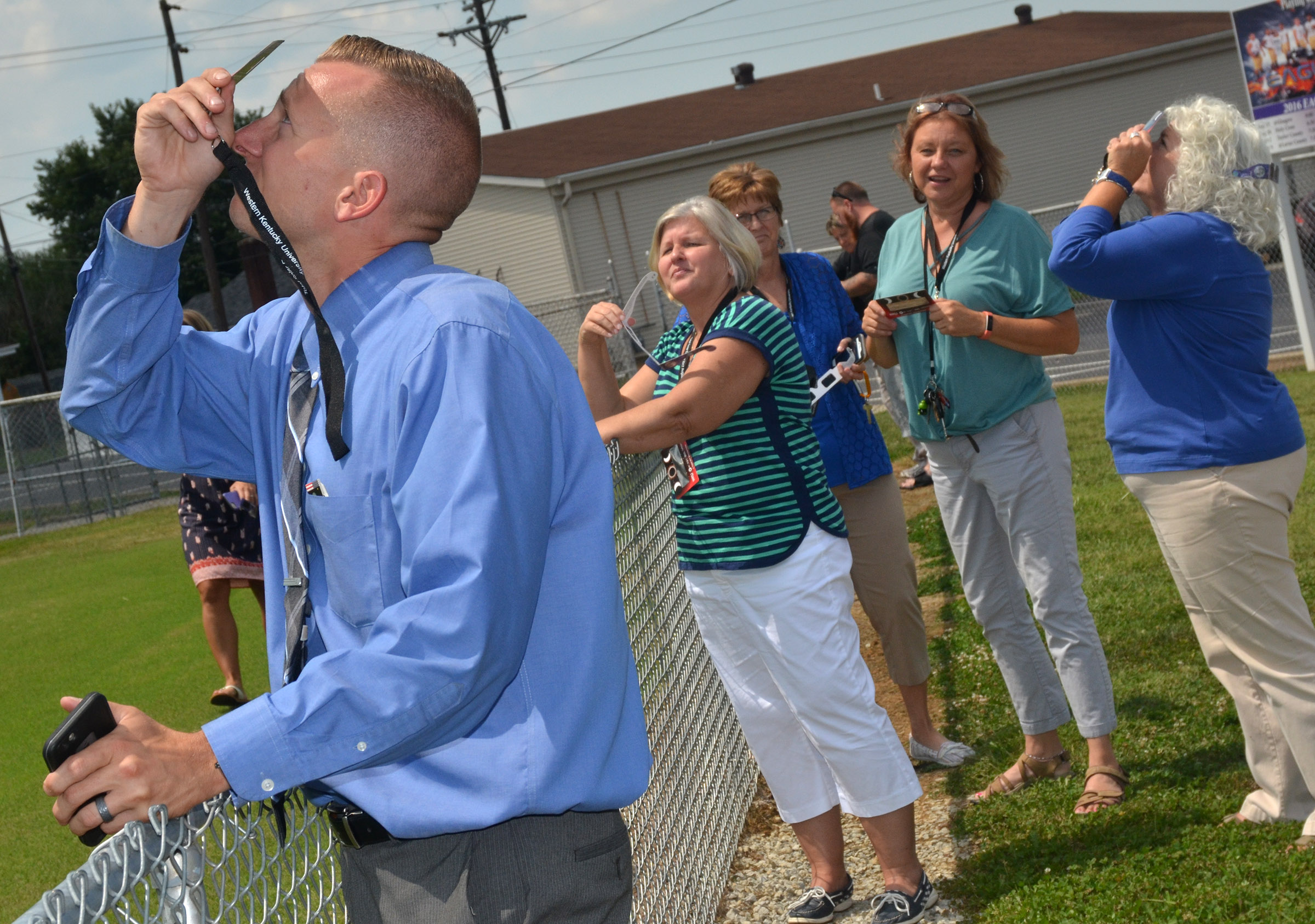 CMS Principal Zach Lewis views the eclipse with his teachers.