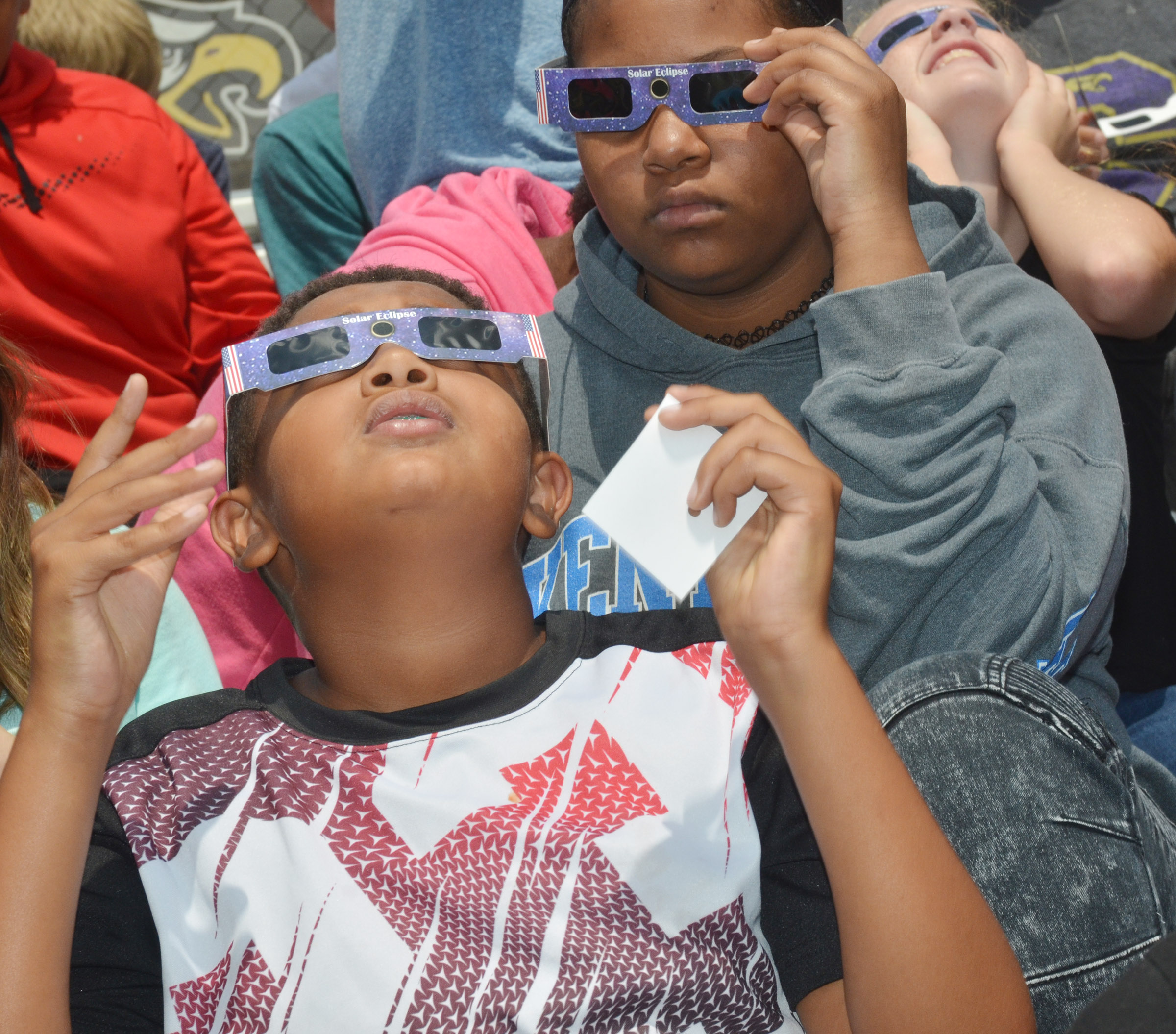 CMS seventh-grader Ronin Smith views the eclipse.