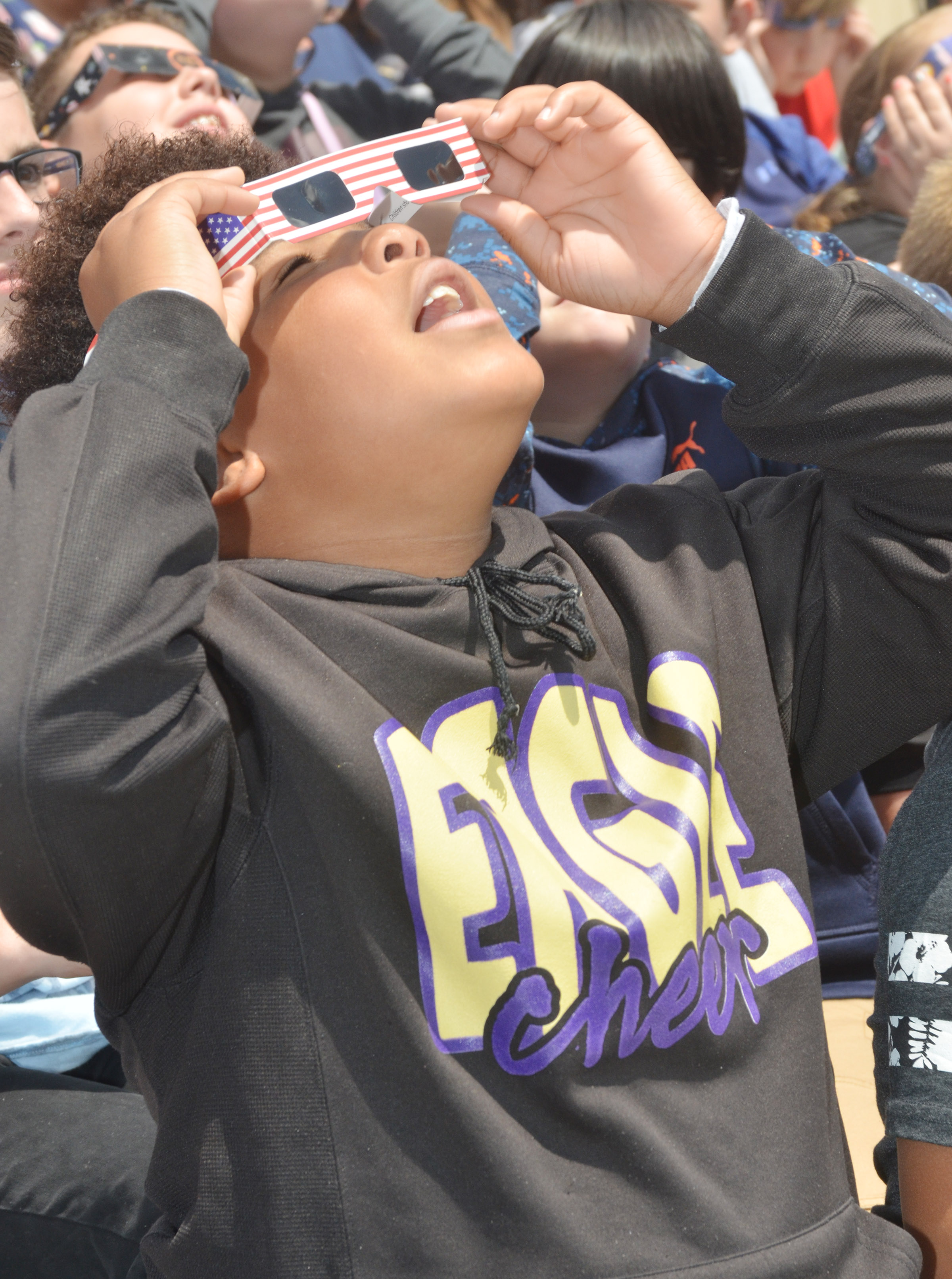 CMS sixth-grader Devin Kinser views the eclipse.