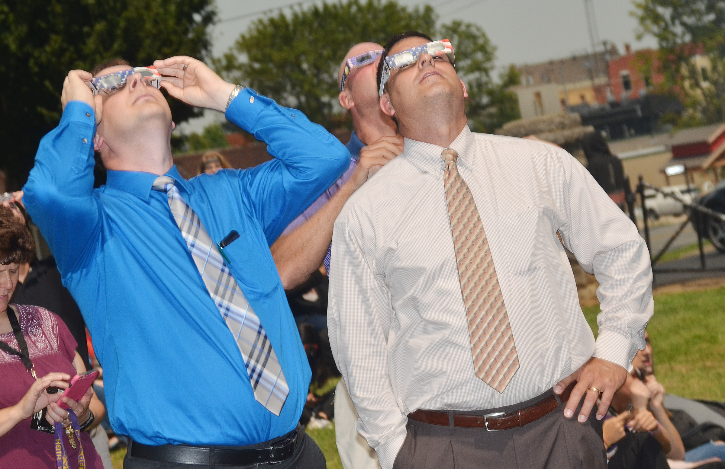 CHS Guidance Counselor Richard Dooley, at left, and Superintendent Kirby Smith view the eclipse.