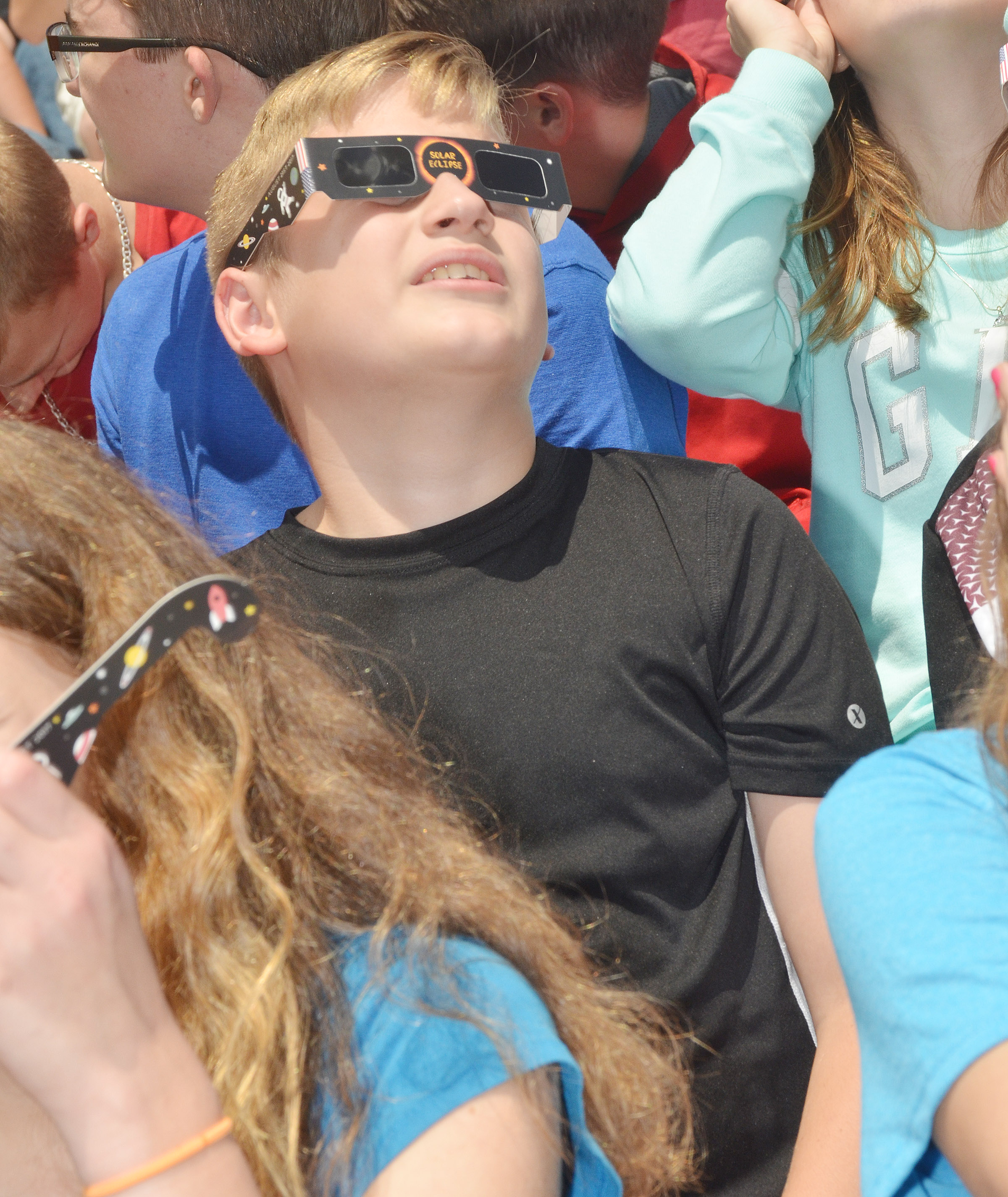 CMS seventh-grader Brady Hoosier views the eclipse.