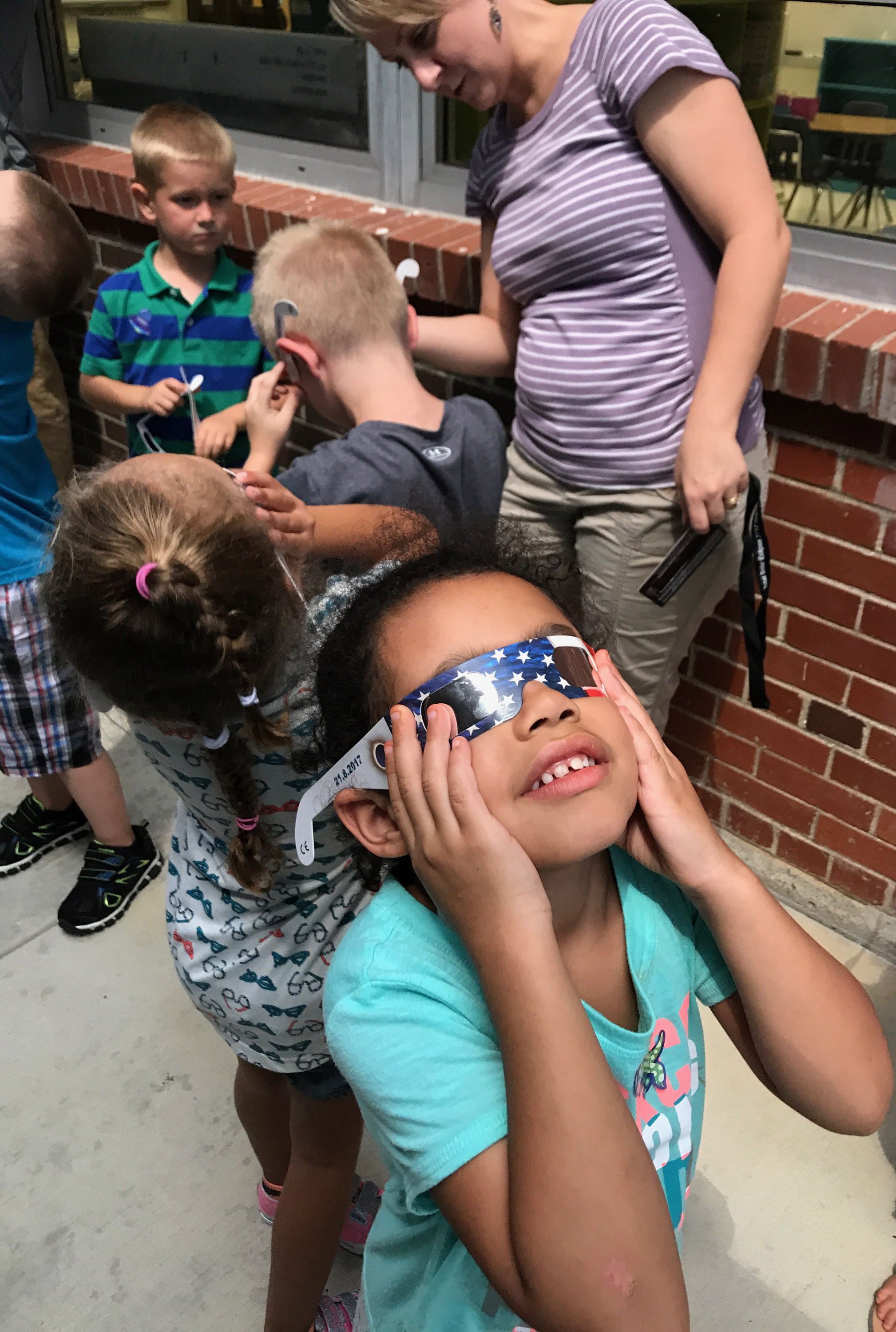 CES kindergartener Rylee Karr views the eclipse.