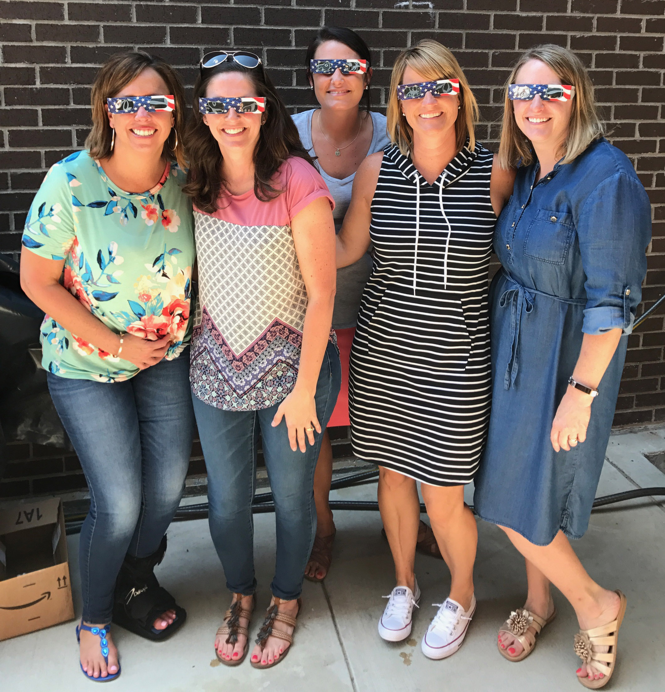 From left, CES teachers Farrah Hord, Adrienne Hash, Amber Johnson, Vanessa Adkins and Laura Dicken view the eclipse.