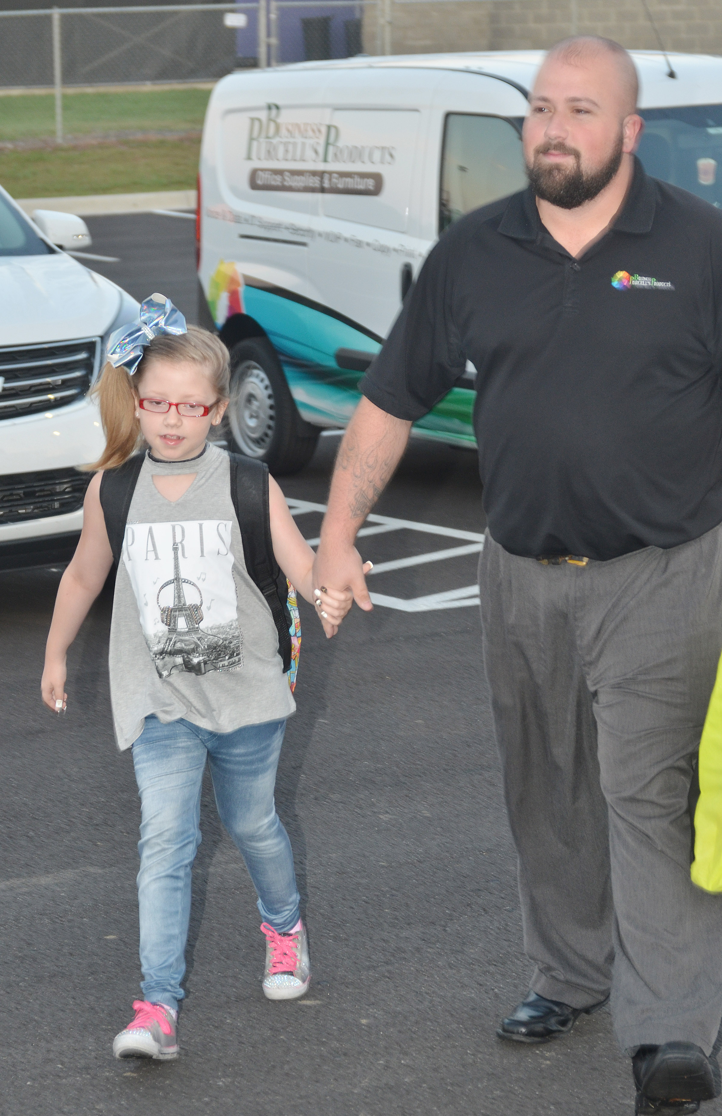 CES fourth-grader Gracie Pendleton walks into school with her dad, Dustin.