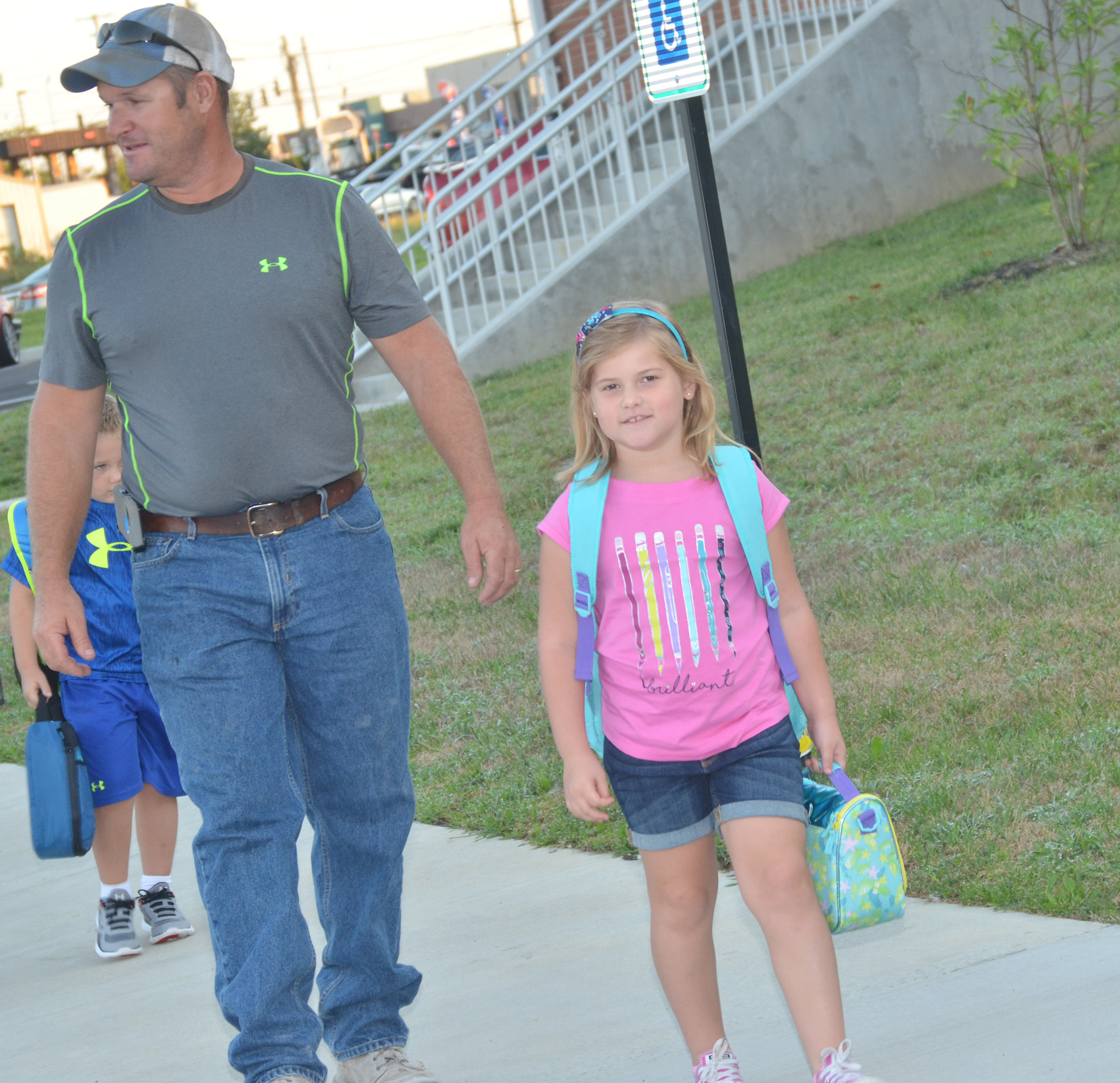 CES first-grader Aubreigh Knifley walks into school with her dad, Lyle.