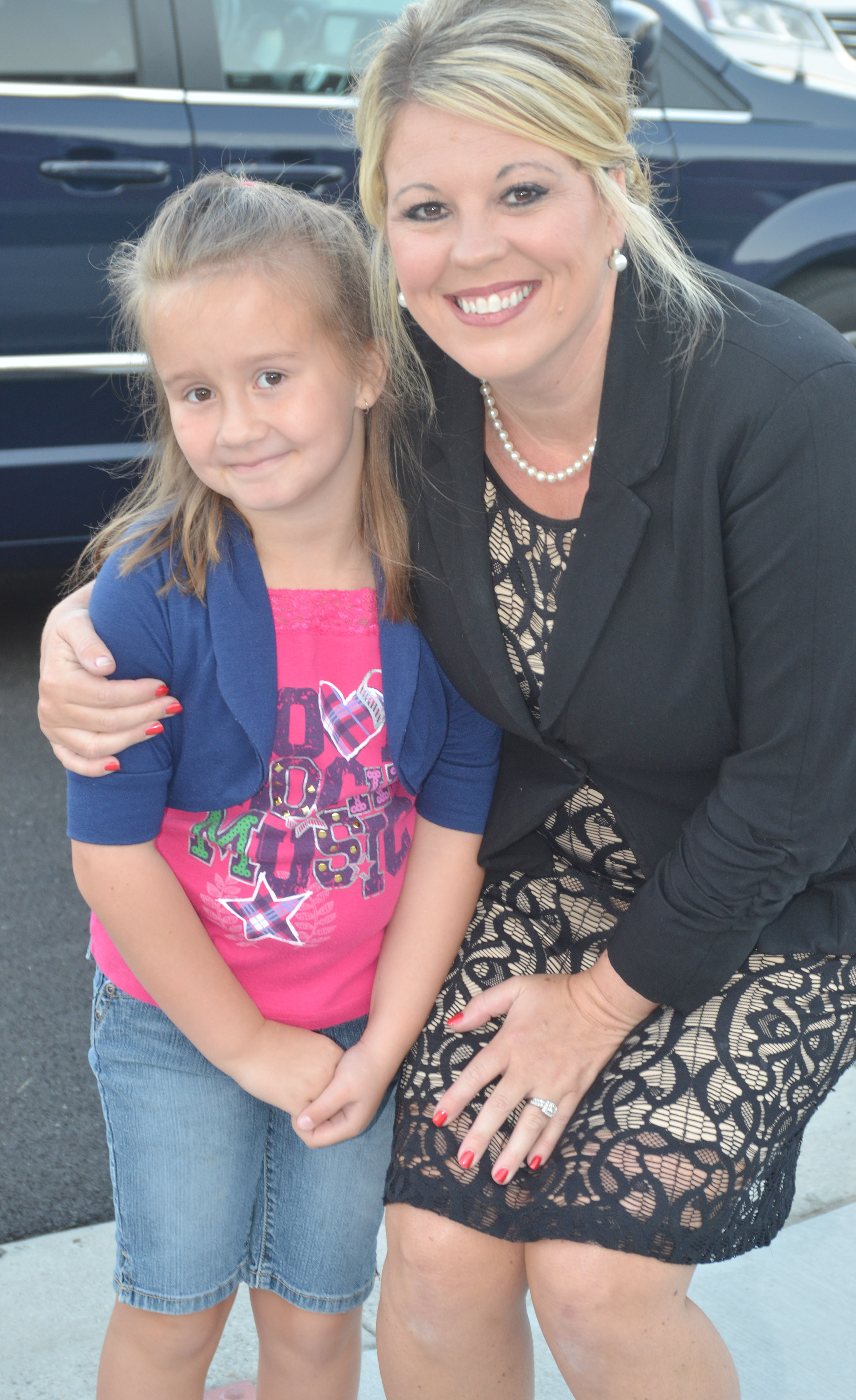 CES Principal Elisha Rhodes takes a photo with first-grader Natalee Shaw.