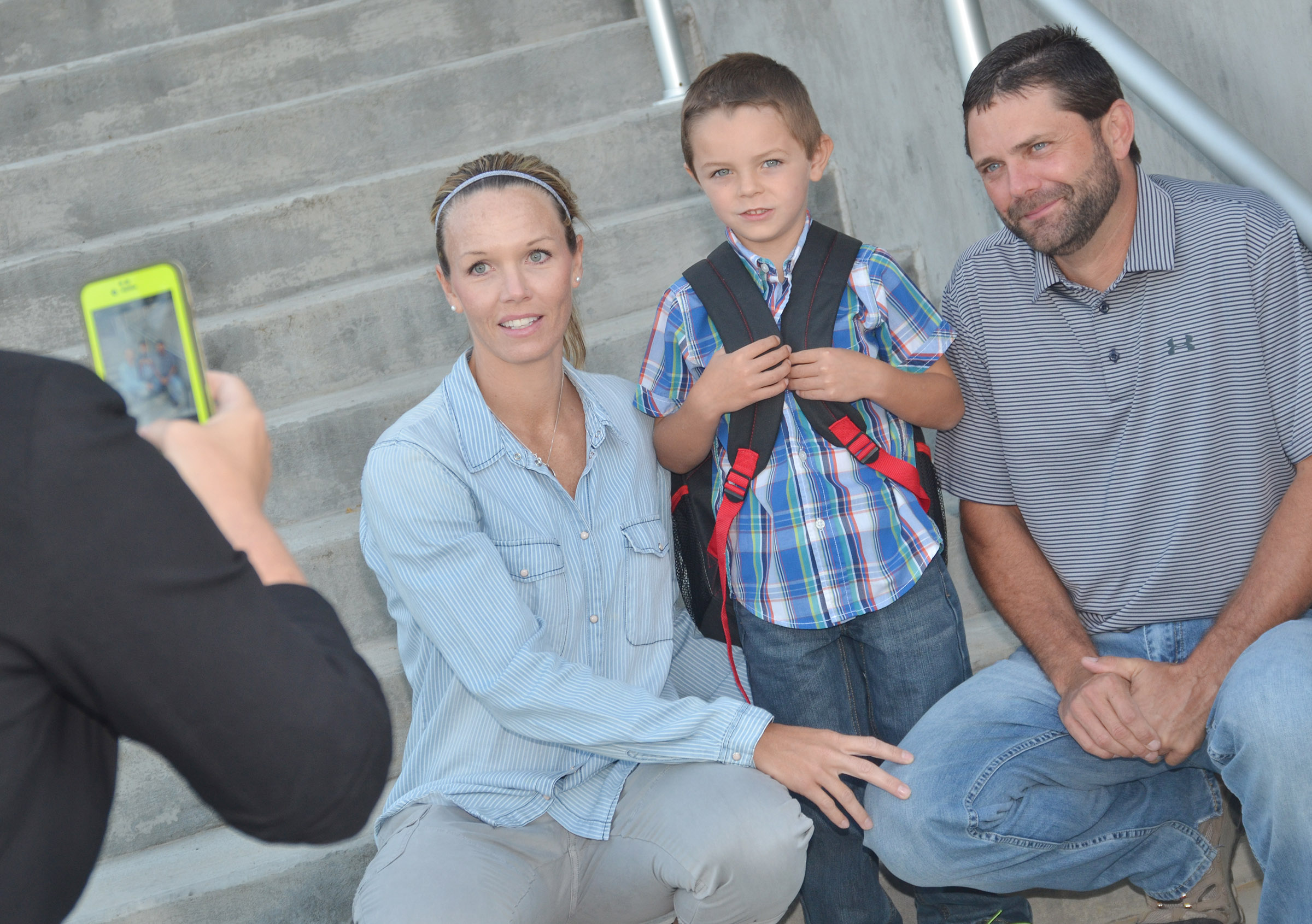 CES kindergartener Hayden Goff takes a photo with his parents, Tasha and Correy. Tasha Goff is an instructional assistant at Campbellsville High School.
