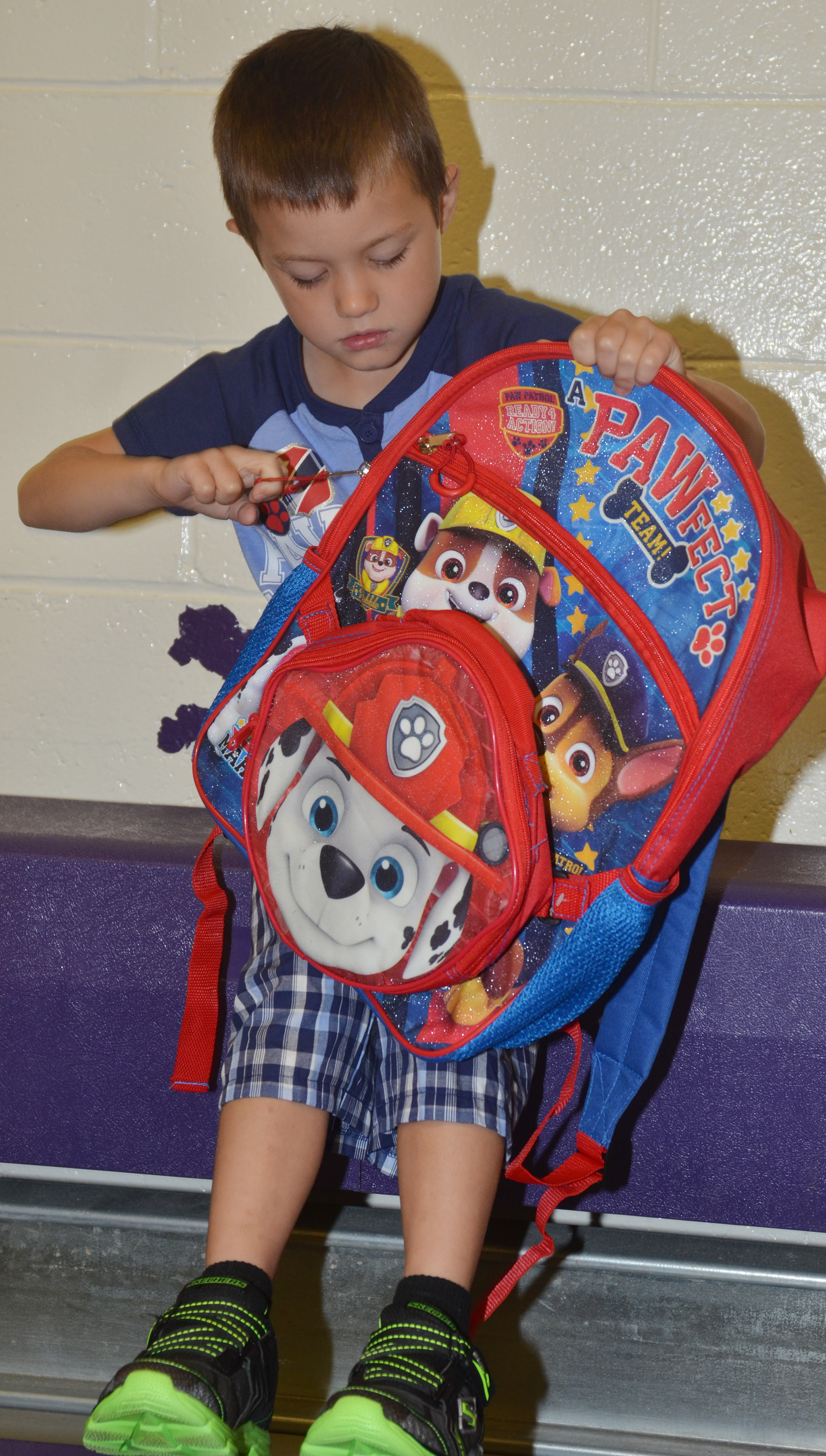 CES kindergartener Levi Ritchie zips his backpack.