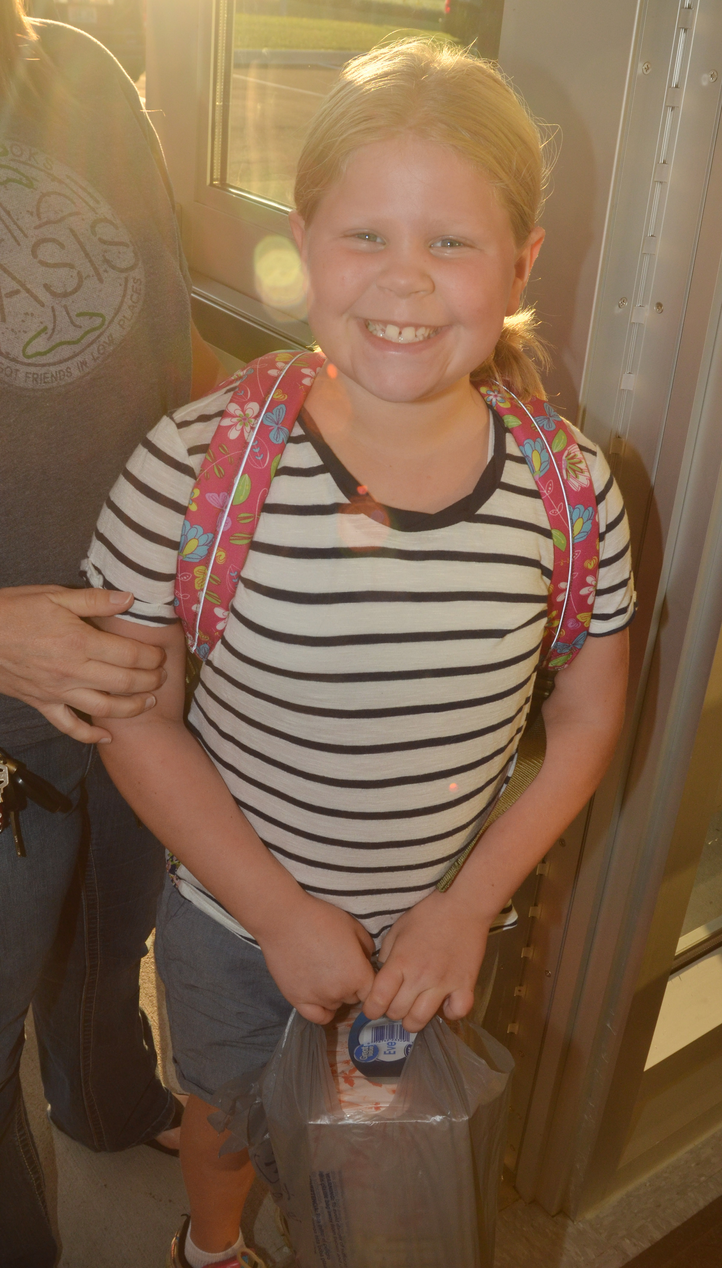 CES third-grader Lily Coots smiles on the first day of school.