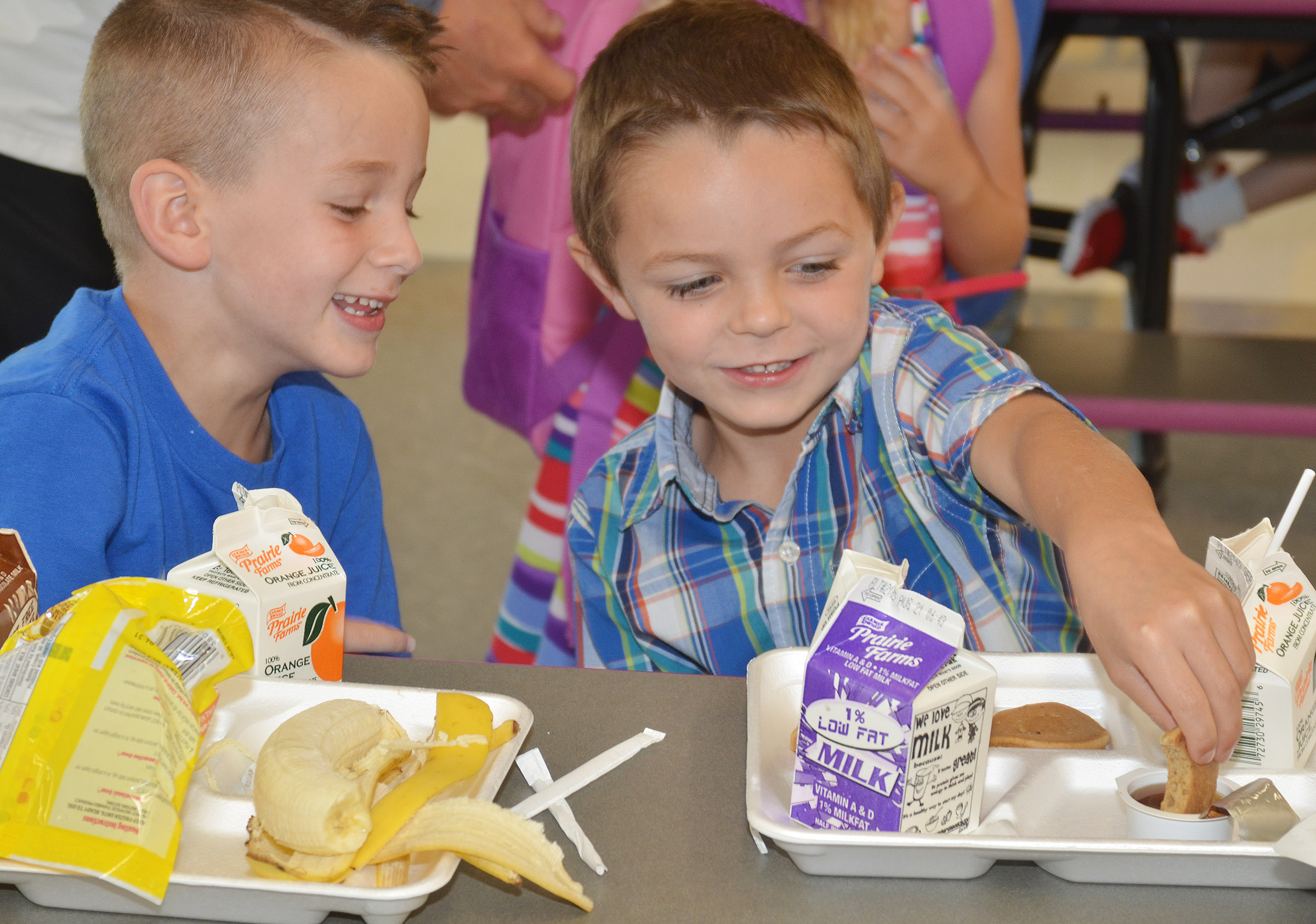 CES kindergarteners Cash Davis, at left, and Hayden Goff talk as they eat breakfast.