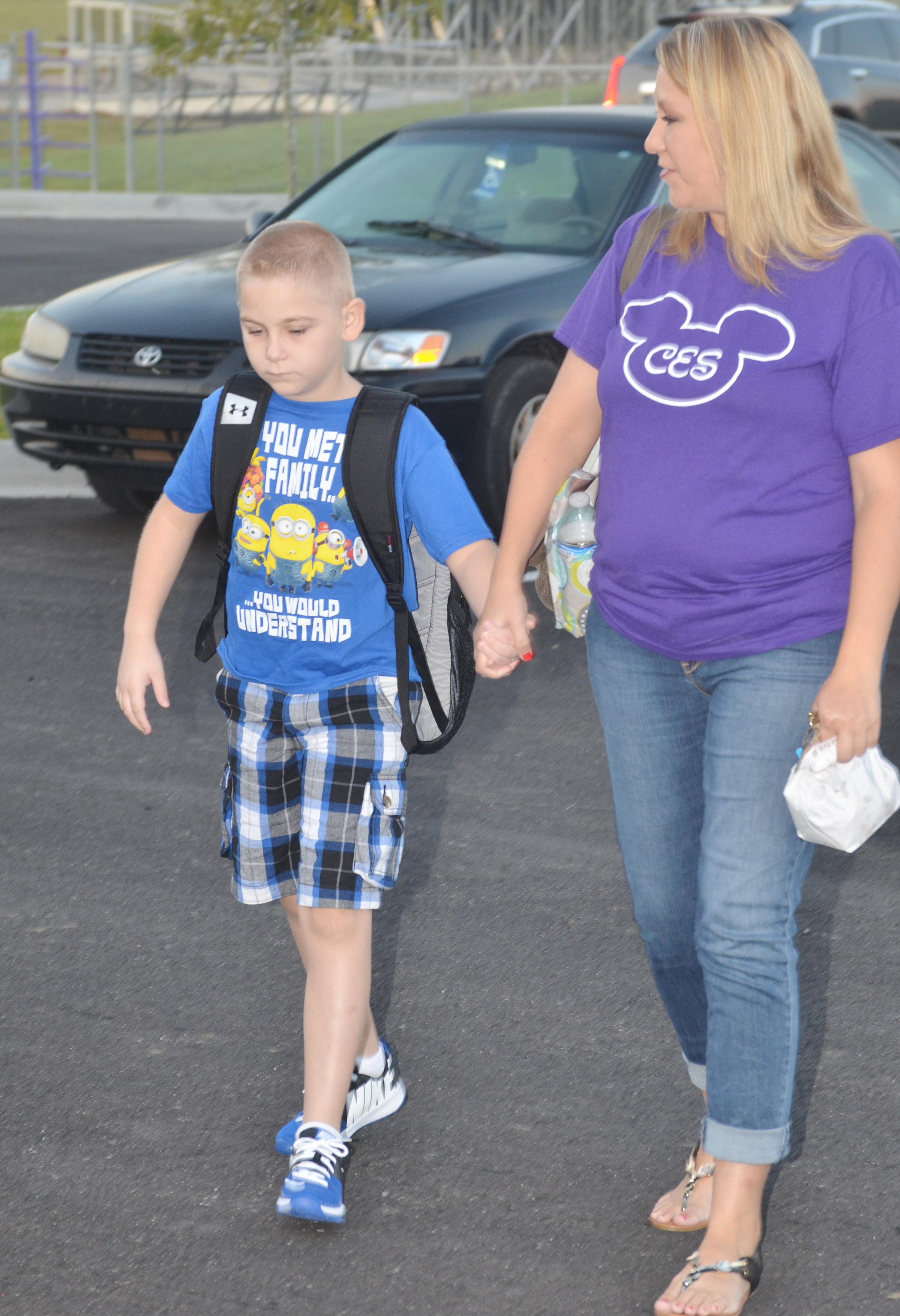 CES first-grade teacher Amanda Greer walks with her son, Joe, who is third-grader at CES, into school.