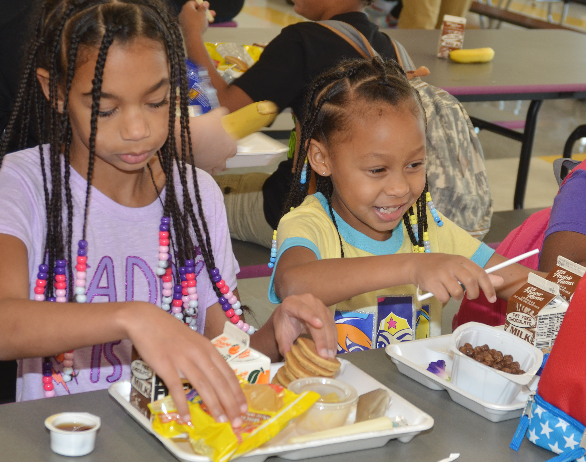 CES fourth-grader De'Asia Fisher, at left, and her sister, Elyzabeth, a first-grader, eat breakfast.