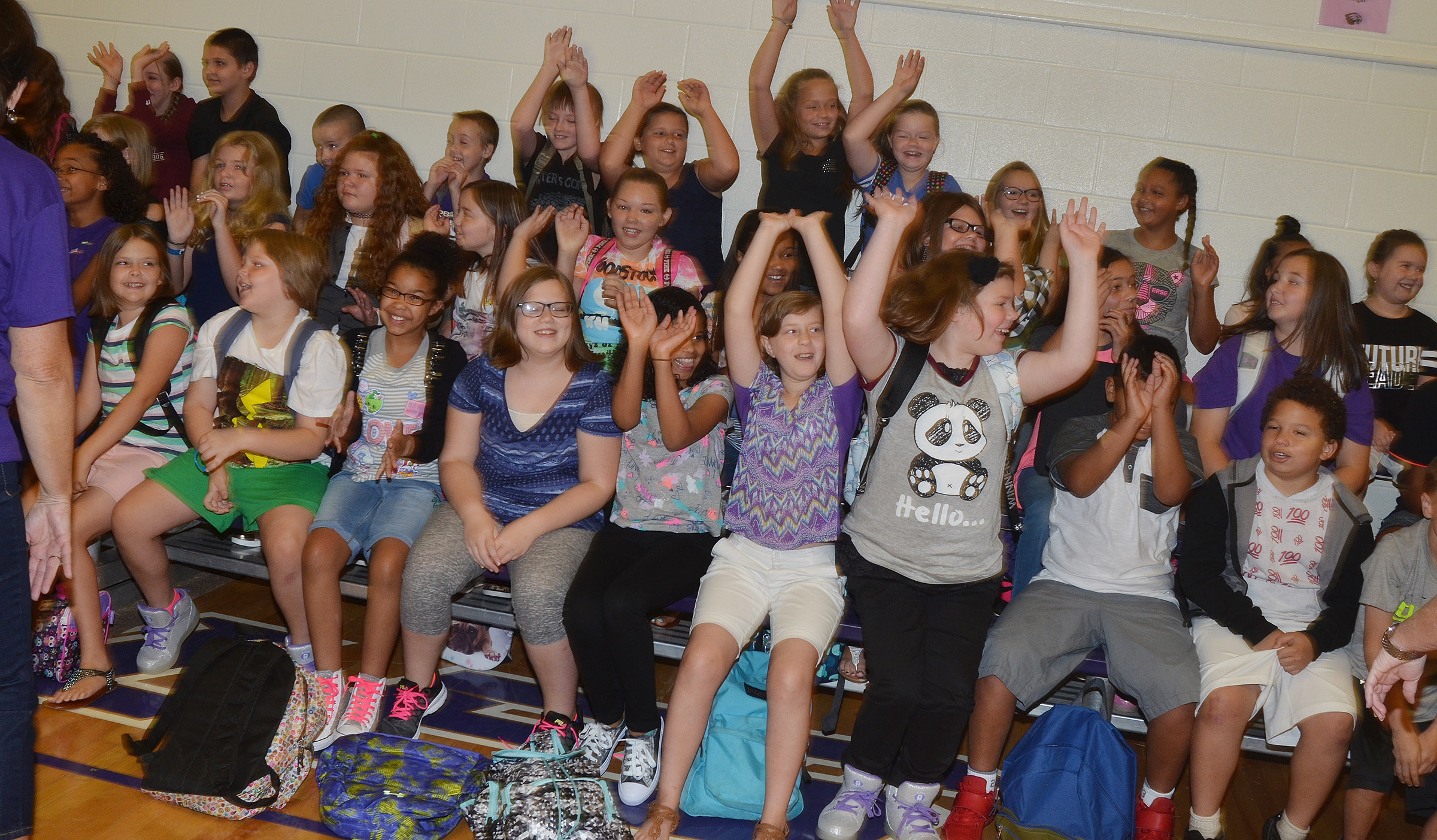 CES fifth-graders do the wave on the first day of school.