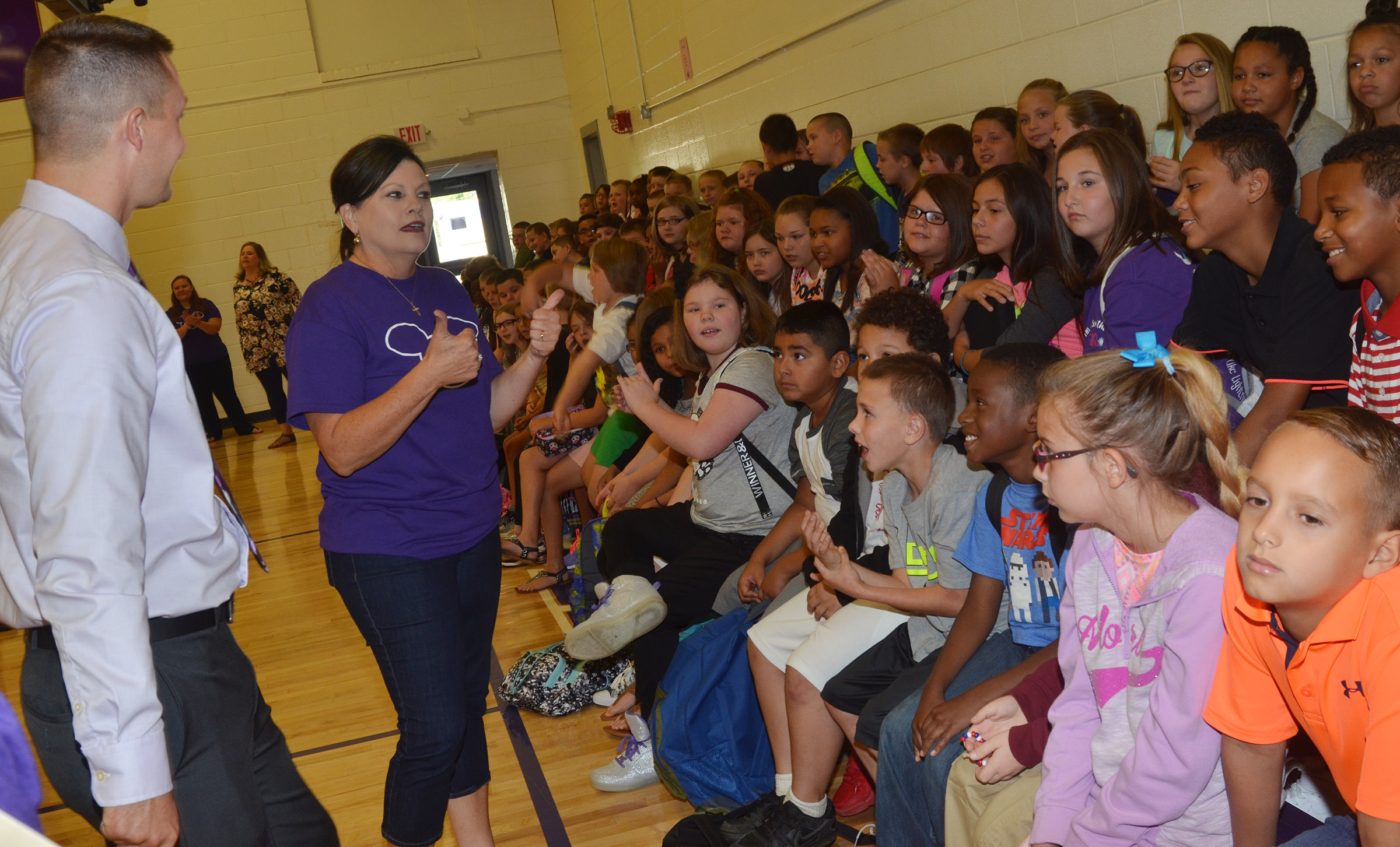 CES Assistant Principal Weston Jones and teacher Lisa Kearney talk to fifth-graders at the start of the day.