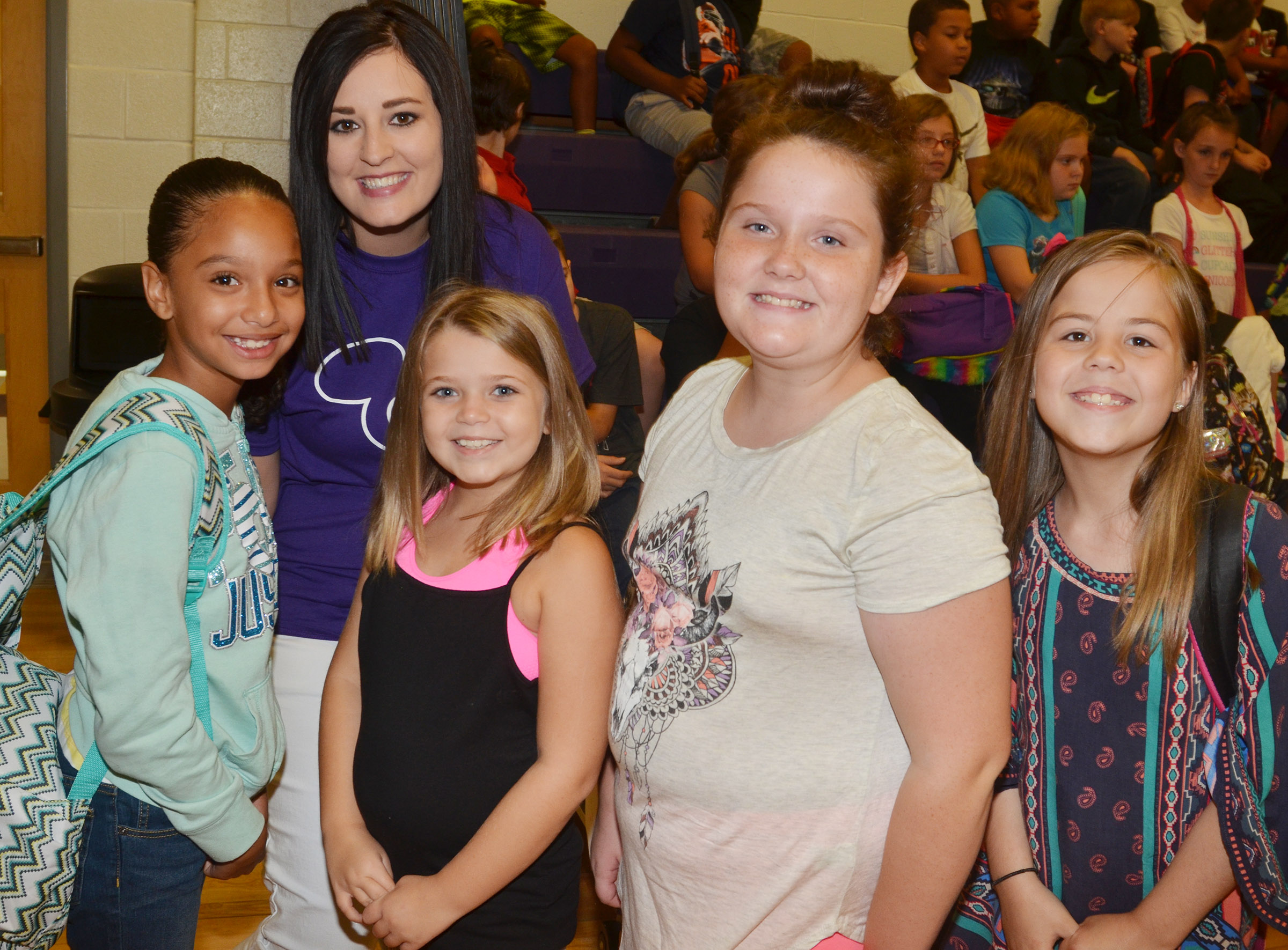 CES teacher Samantha Coomer poses for a photo with her fourth-grade students, from left, Alyssa Knezevic, Chyanne Christie, Madison Philpott and Chloe Bates.